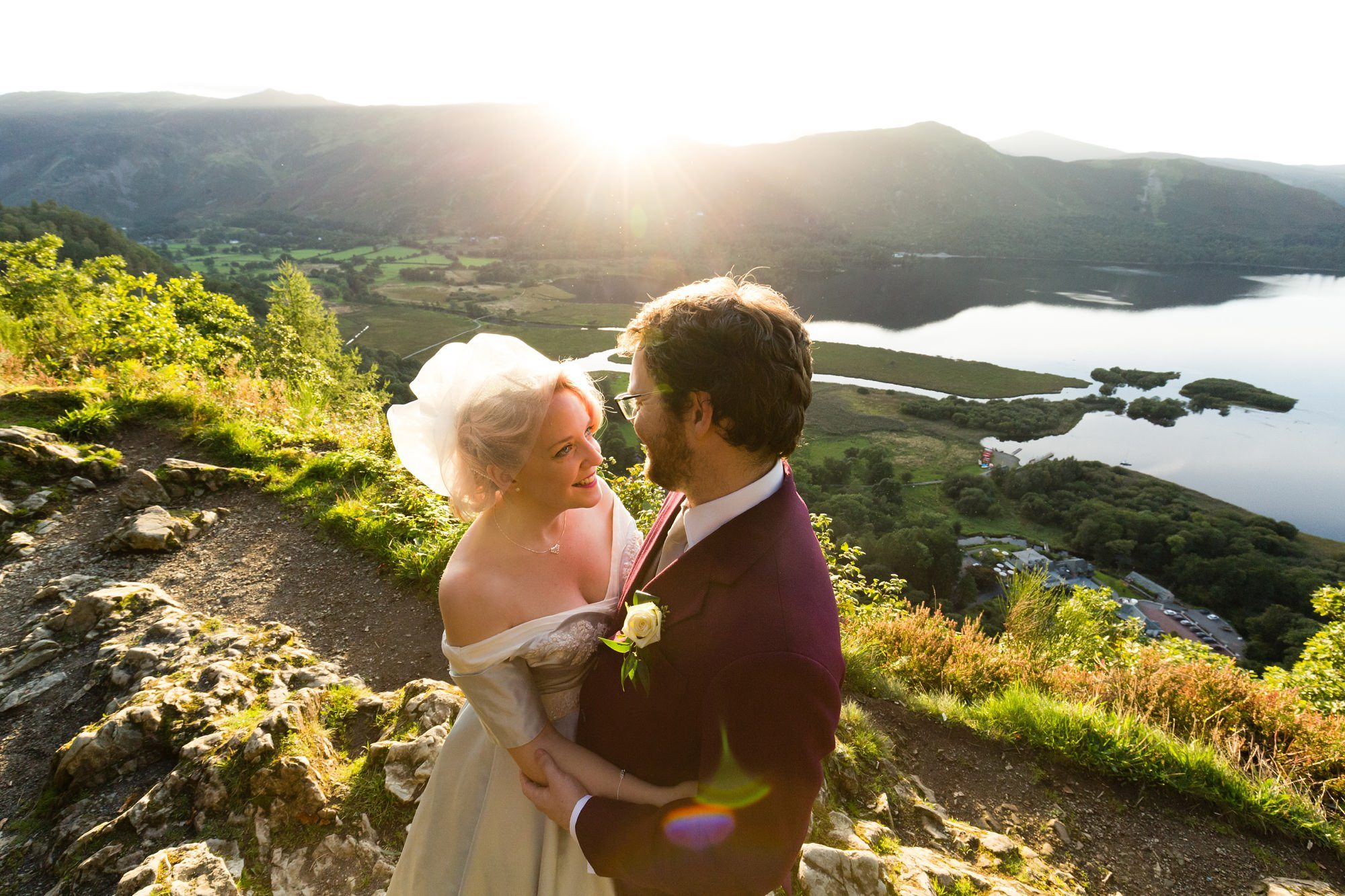 Bride in groom in sunset overlooking lake Derwentwater Independent Hostel Wedding