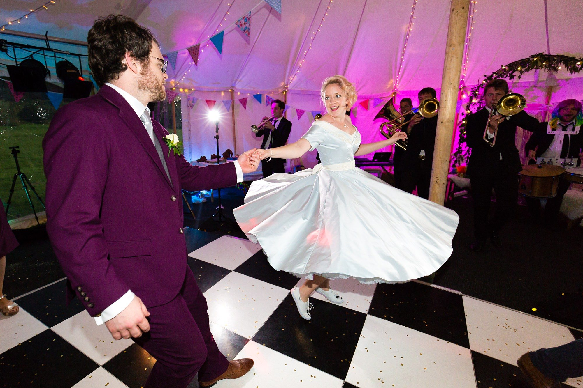 Twirly blue wedding dress dancing on chequerboard floor Derwentwater Independent Hostel Wedding