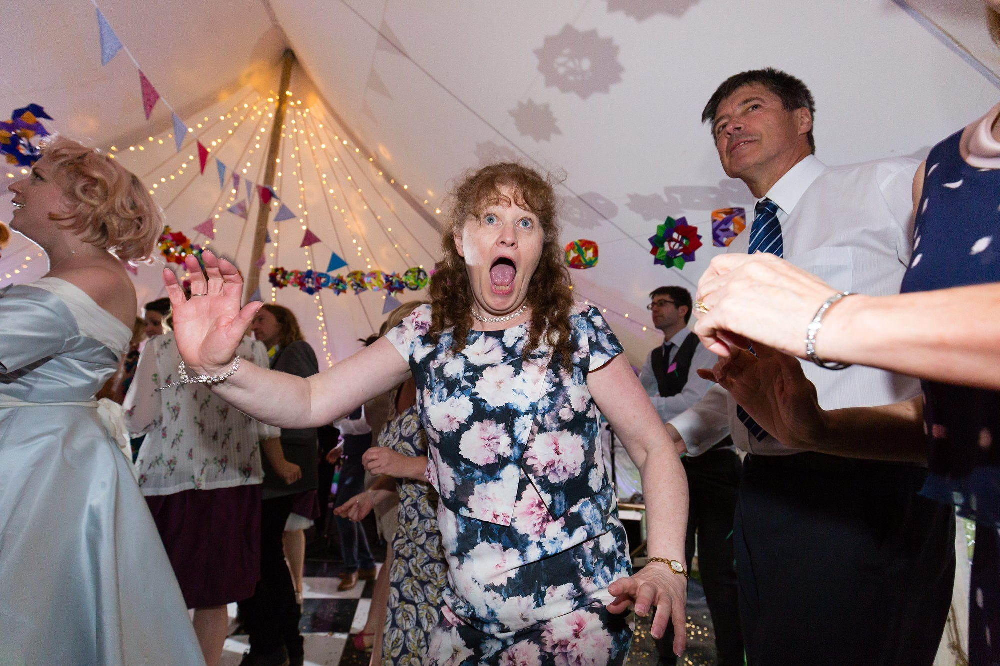 Funny faces during dancing at Derwentwater Independent Hostel Wedding