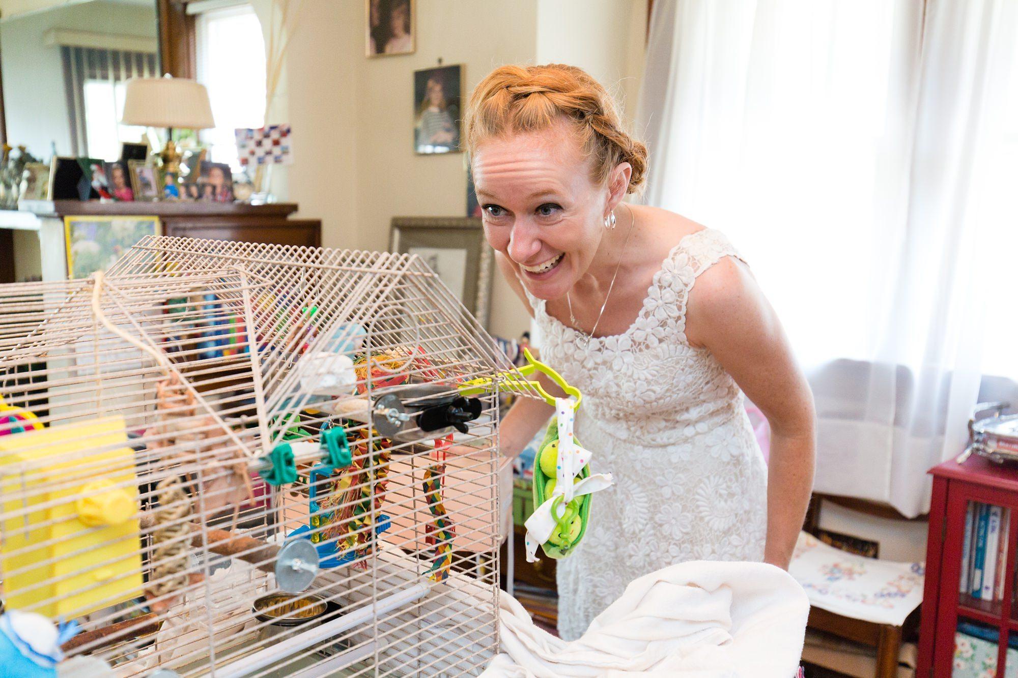Bride talks to her parakeetlet