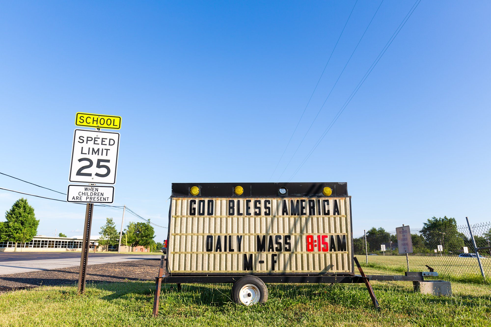God bless America sign next to speed limit sign in Ft. Wayne Indiana