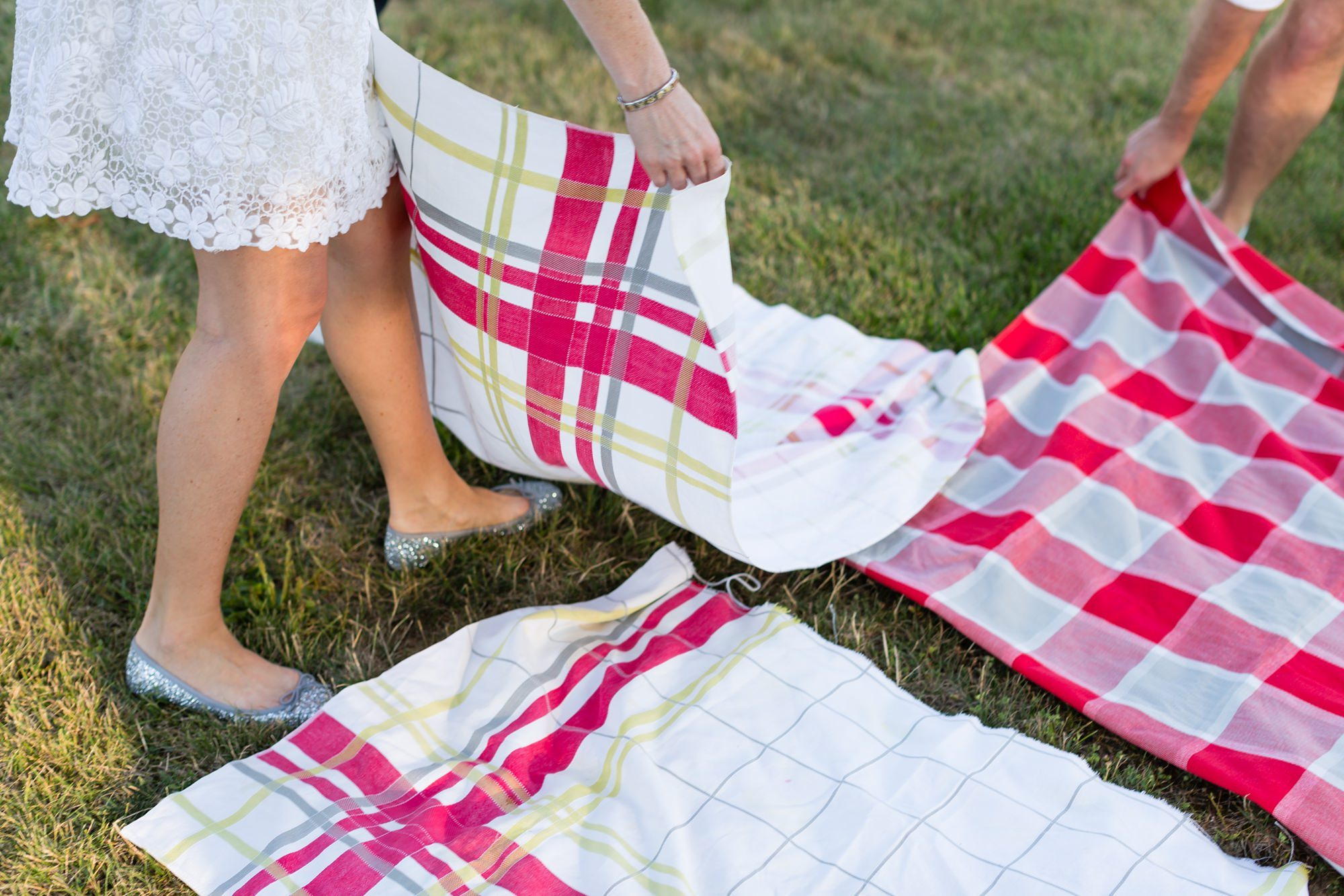 Picnic blankets being spread out for intimate wedding