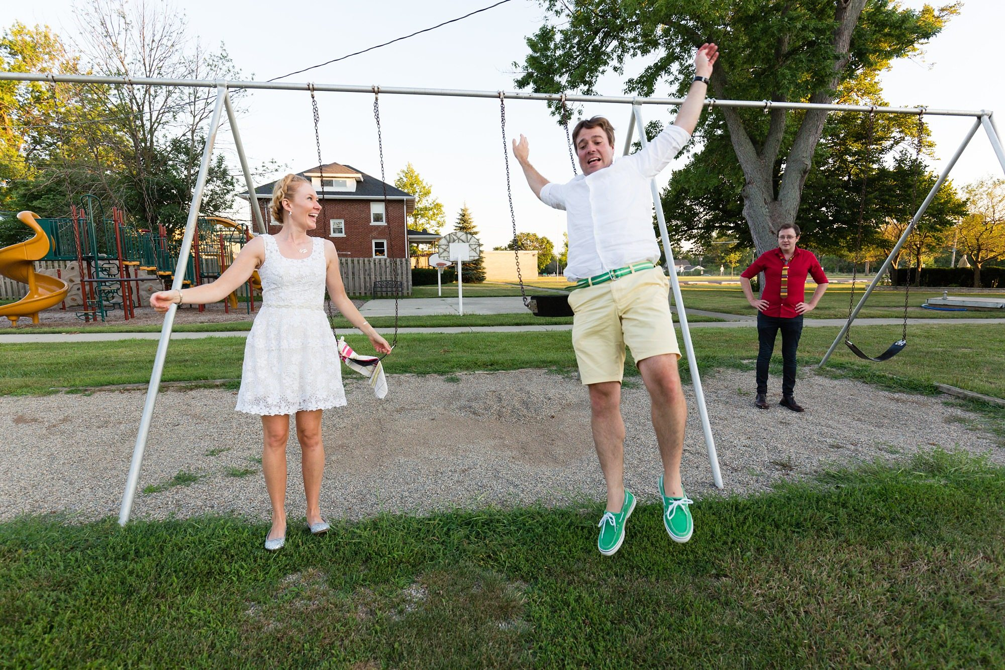 Groom jumps off swing at destination wedding in Ft. Wayne Indiana