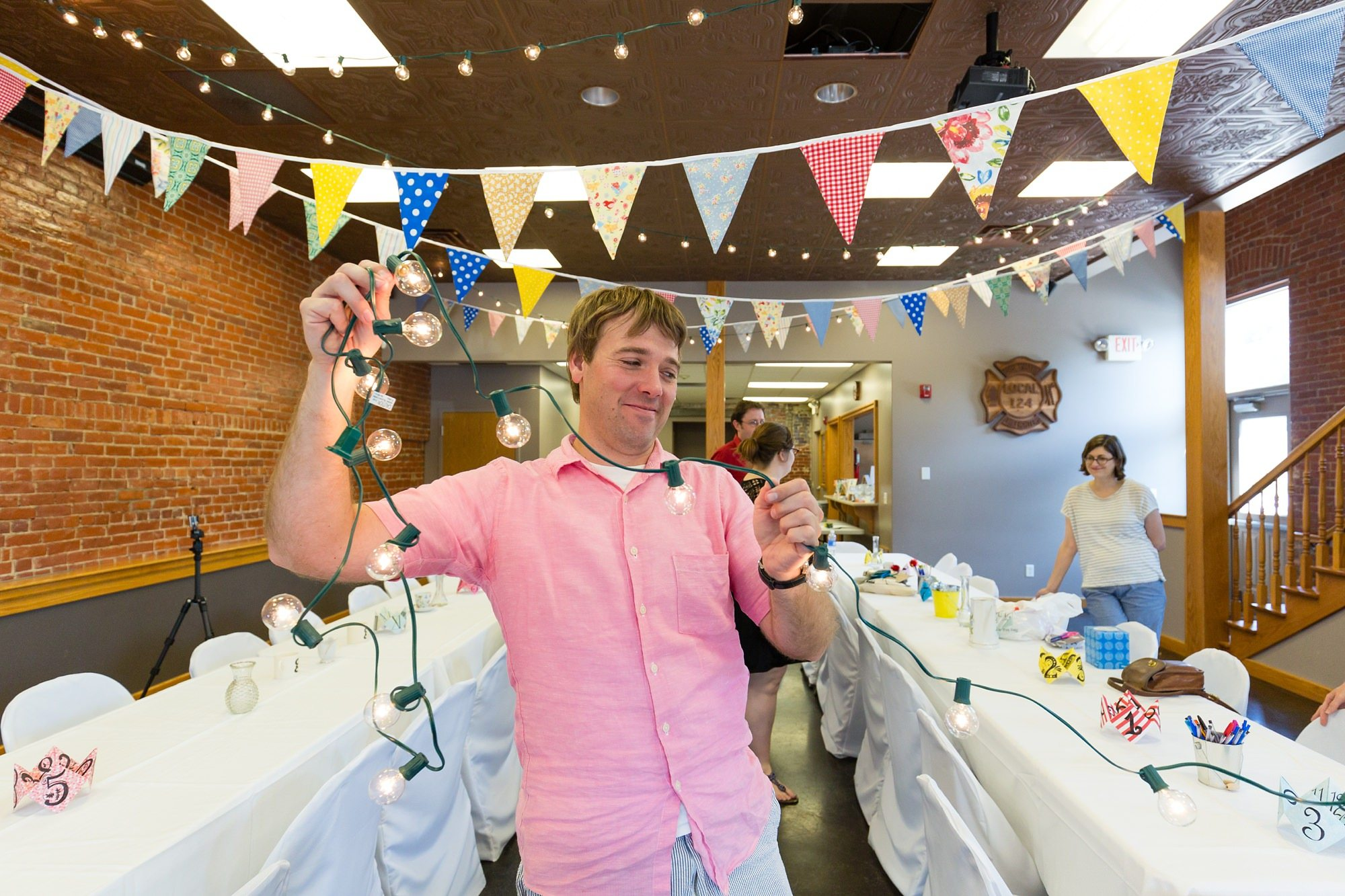 Groom decorates with bunting at destination wedding in Ft. Wayne Indiana
