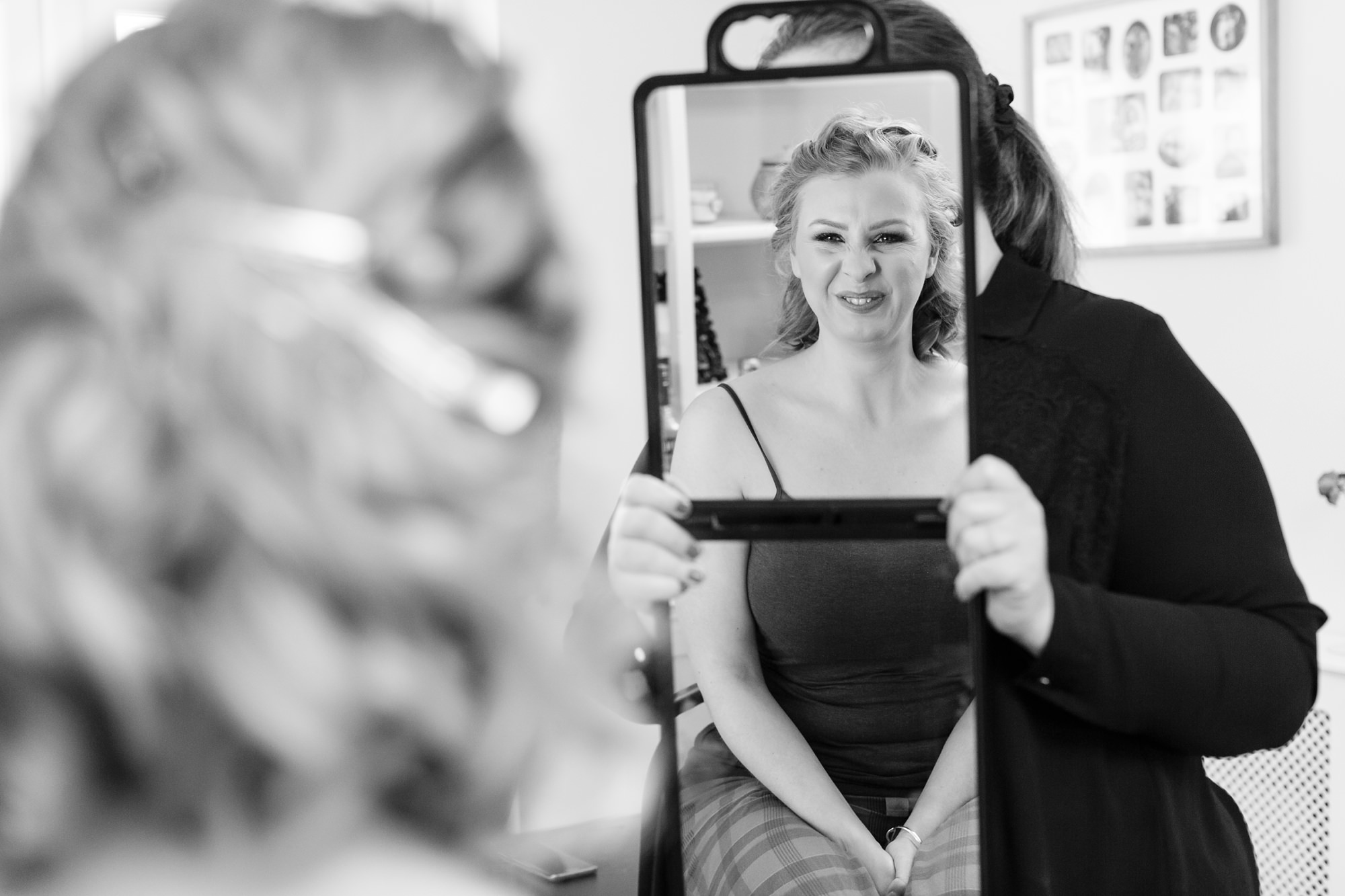 Reflection of bride in the mirror at York wedding