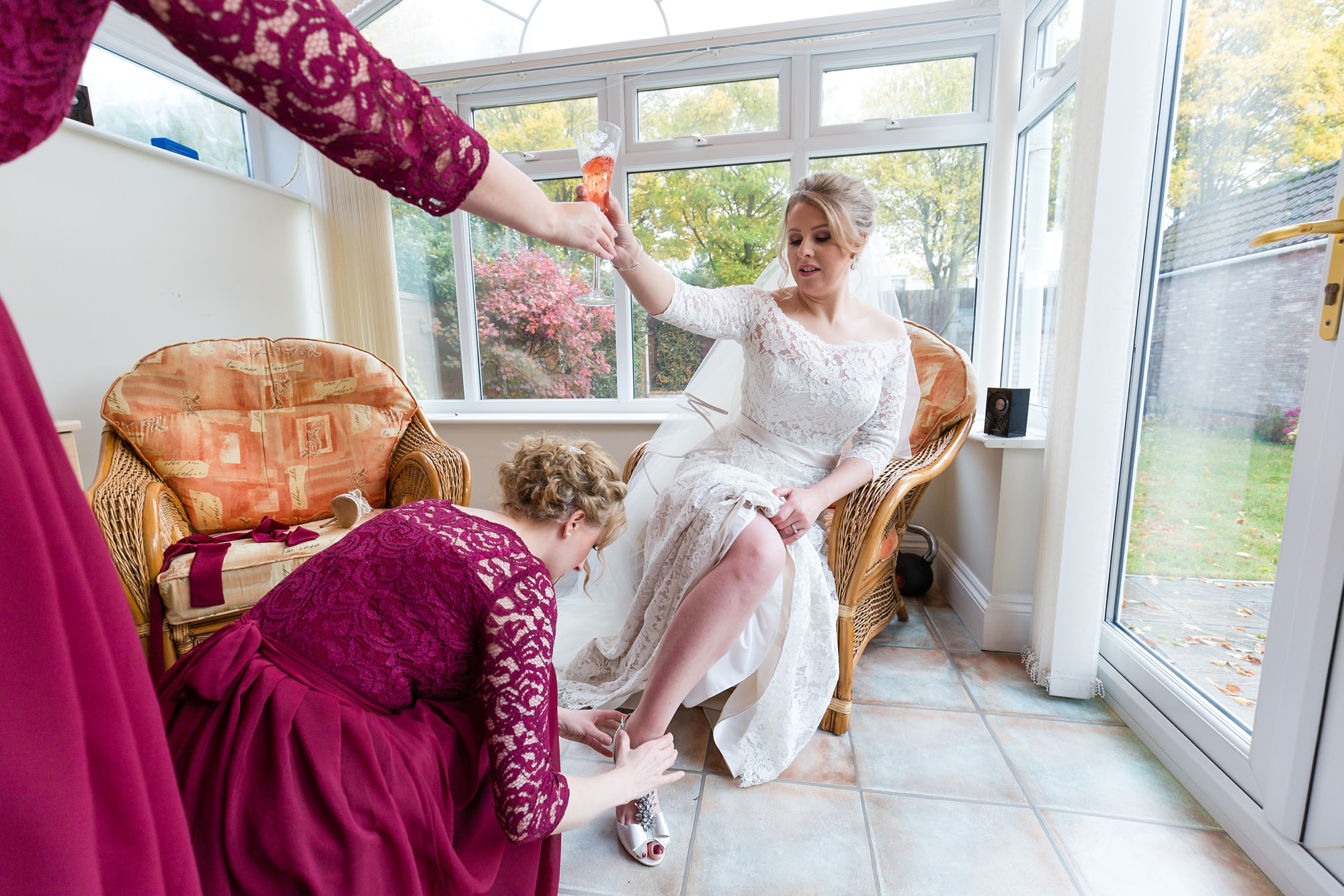 Bride handed a glass of champagne at York Wedding