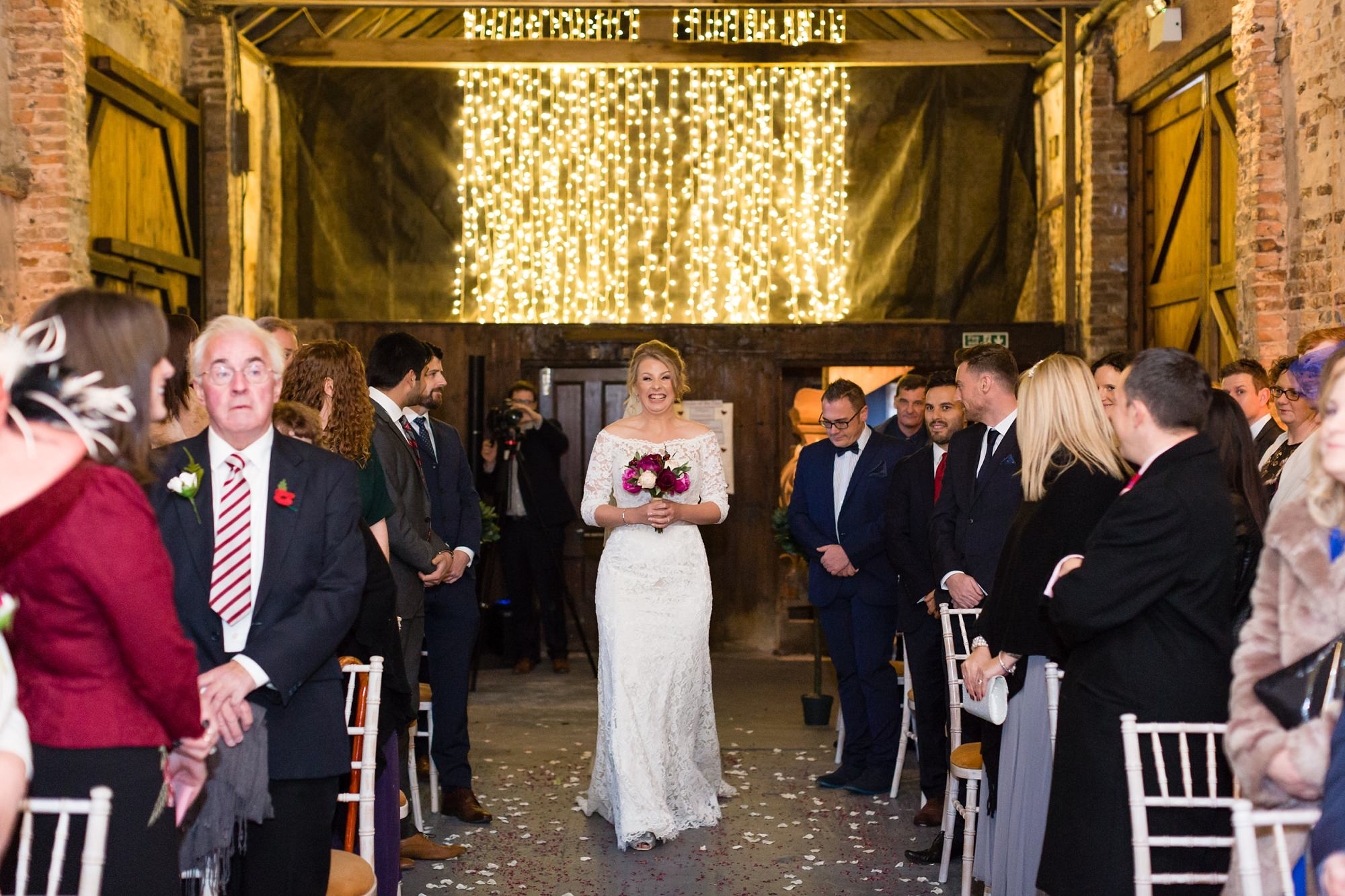 Bride walks up aisle at The Normans in York