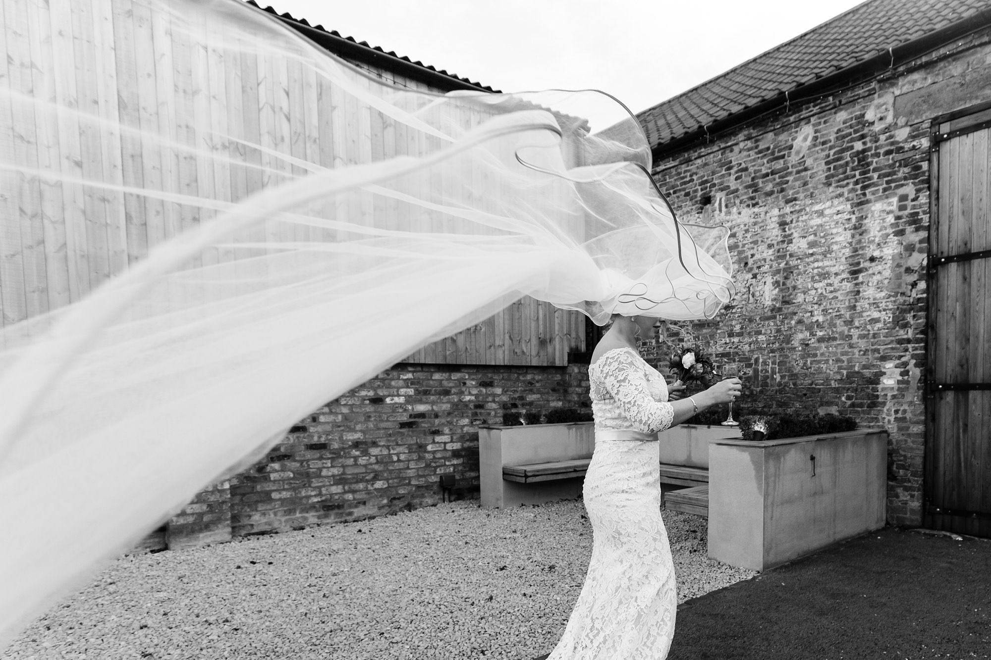 Bride's veil caught int he wind at The Normans in York