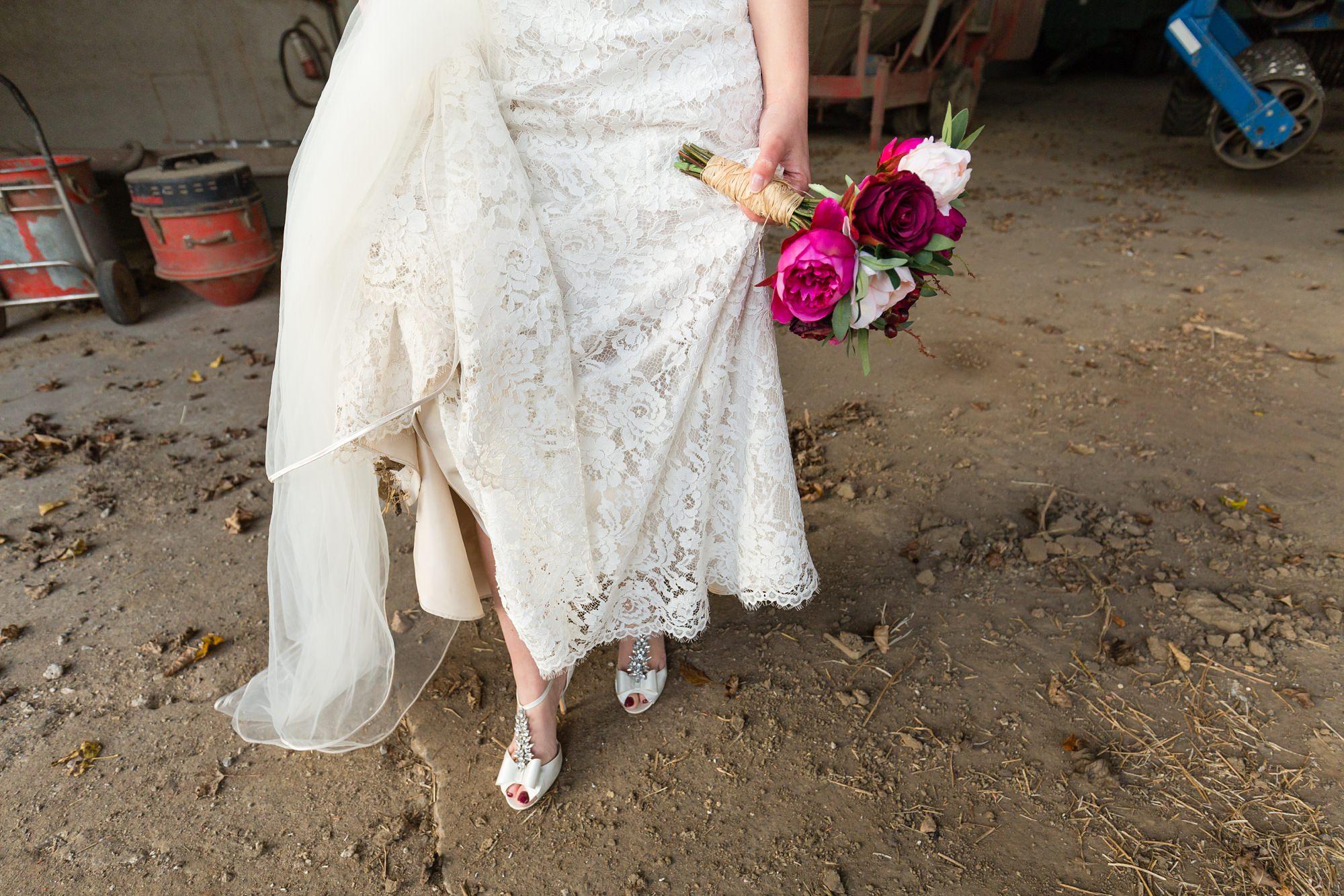 Bride shows lace dress details