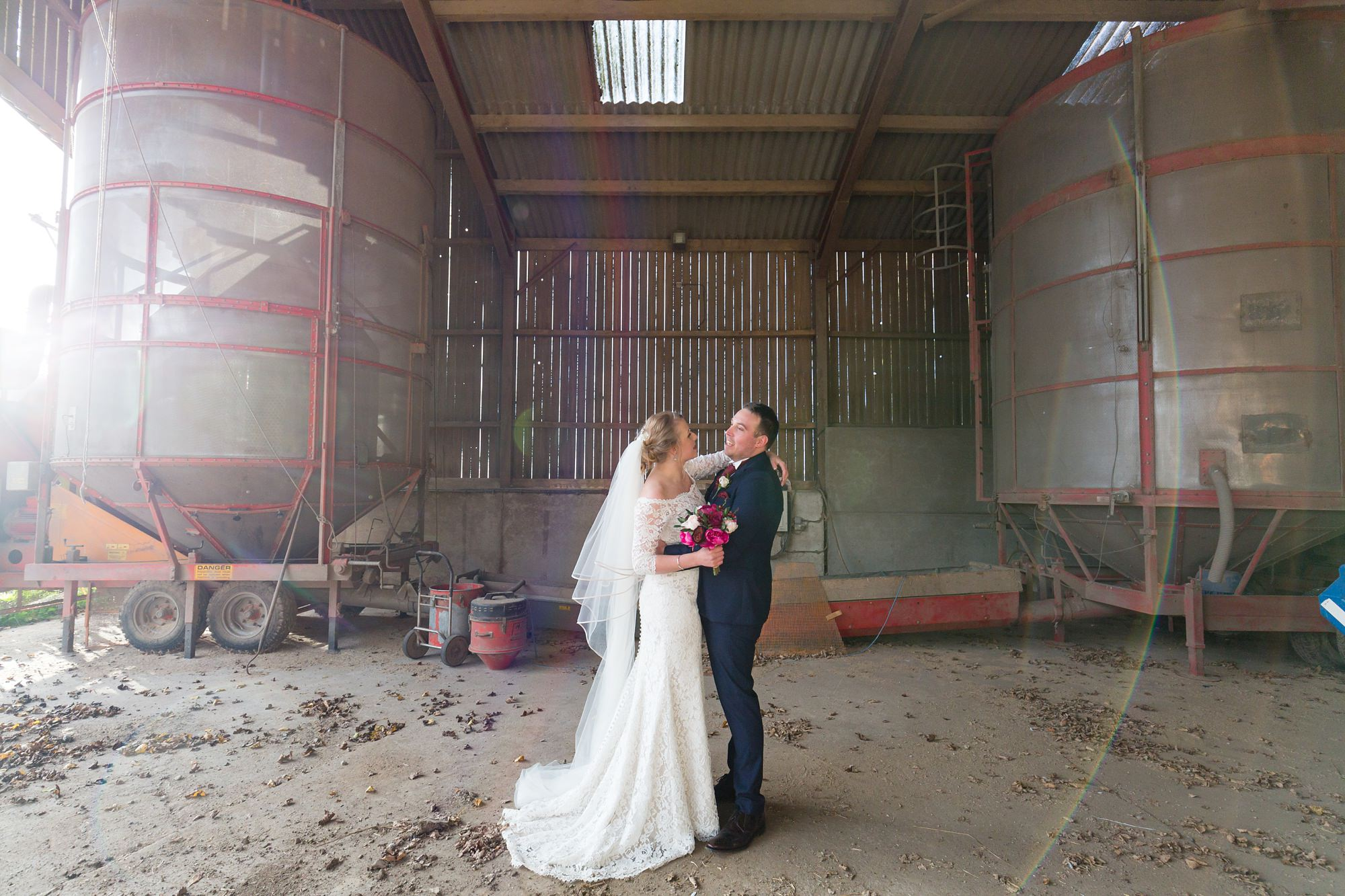 Bride & groom in the barn at The Normans wedding venue in York