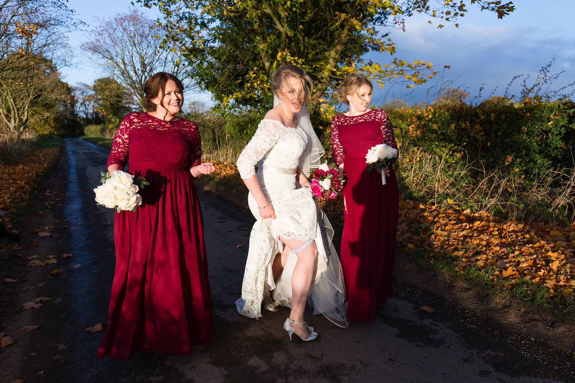 Bride shows off her garter at The Normans funny wedding photography