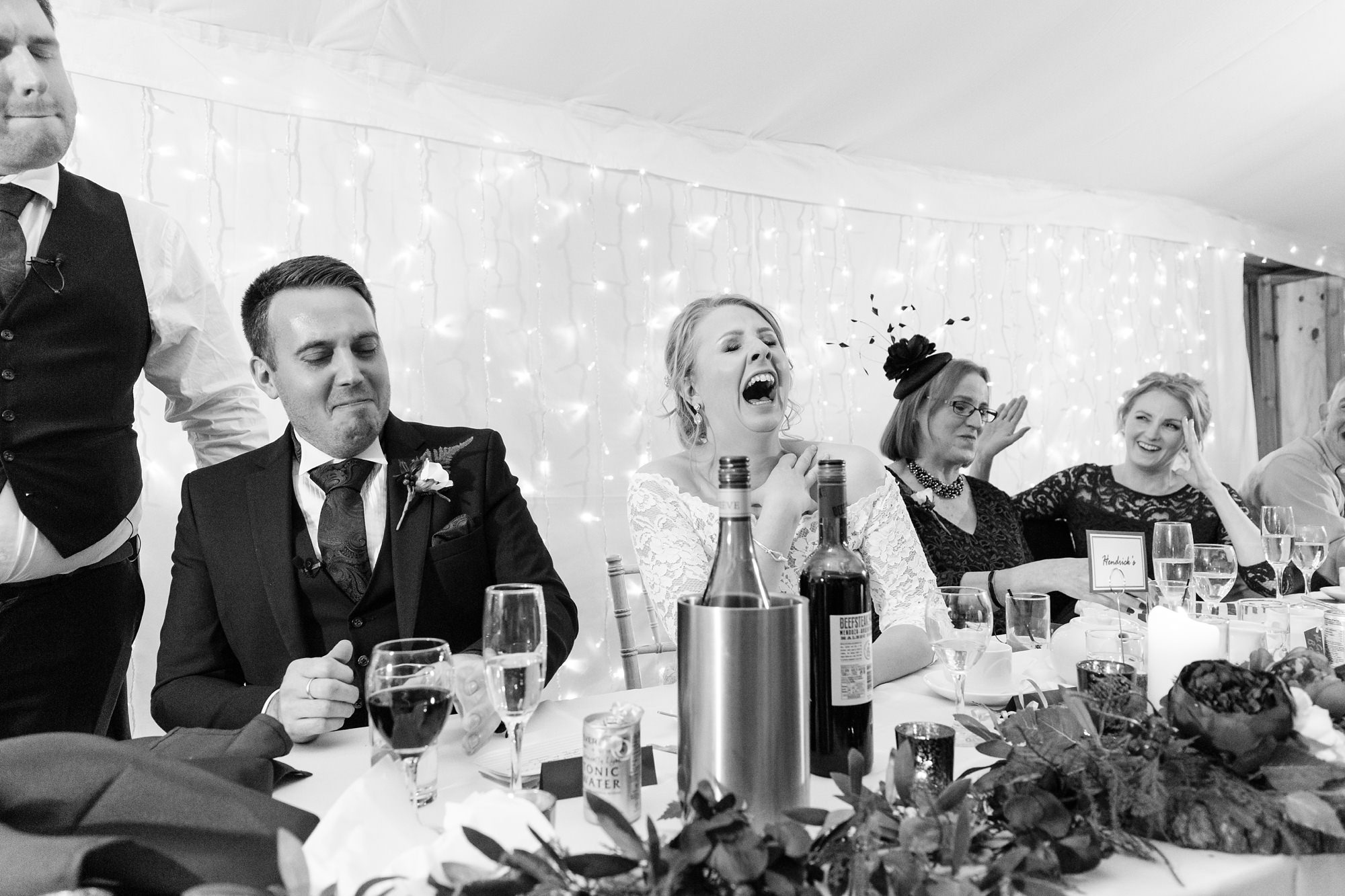 Bride laughing really hard at the speeches at York wedding.