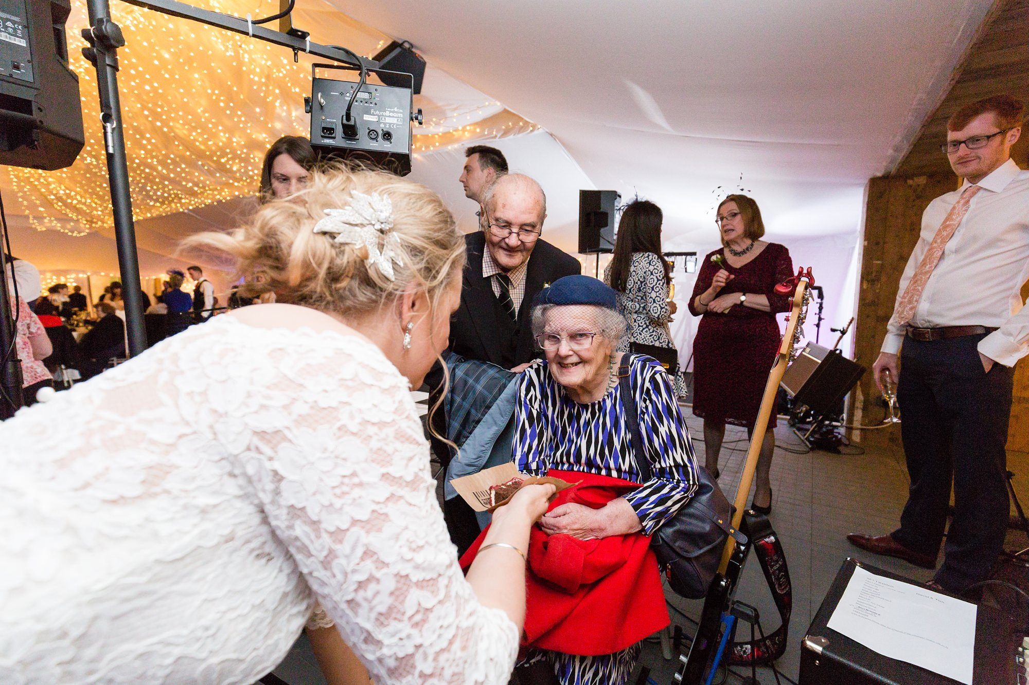 Bride gives cake to grandmother at York wedding
