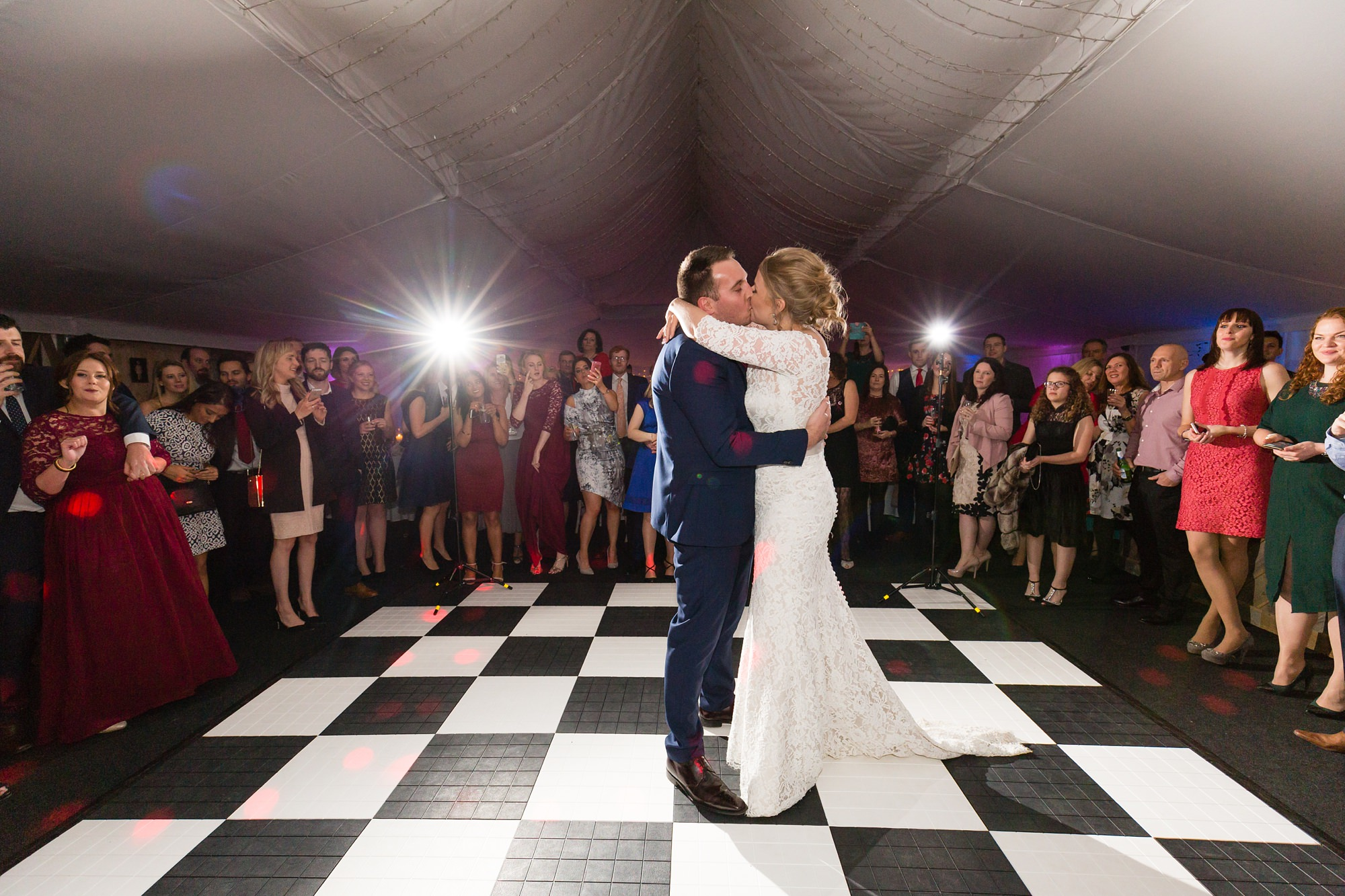 Bride & Grooms first dance on chequered dance floor at The Normans