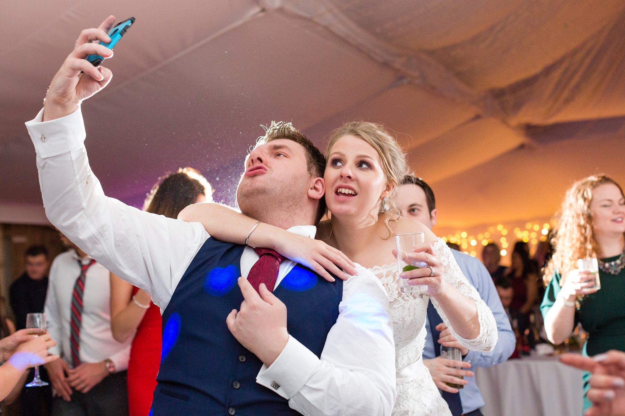Bride & best man take selfie together