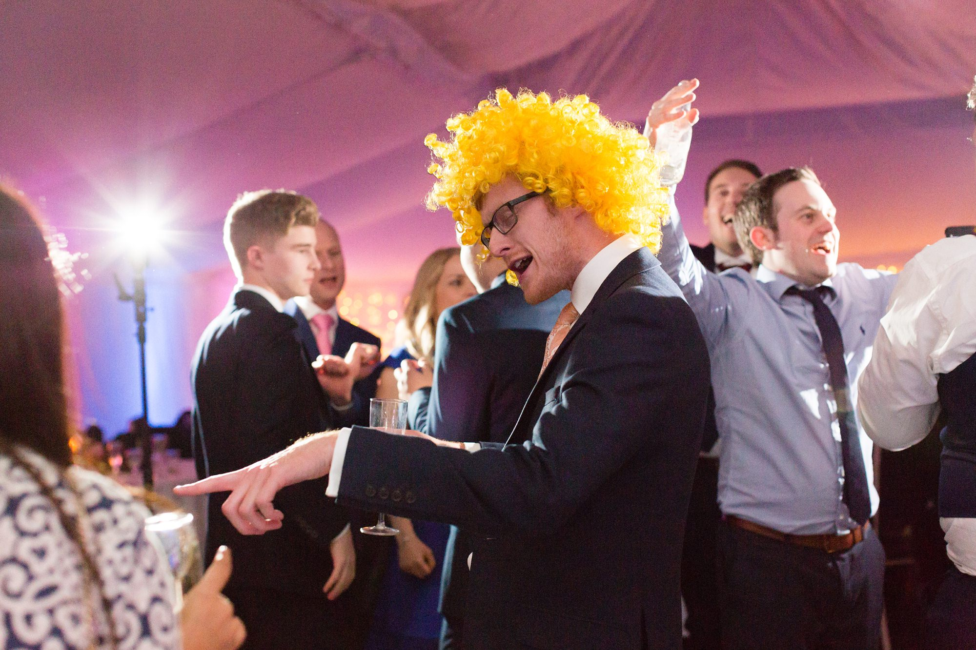 Silly guest wears yellow wig at York wedding
