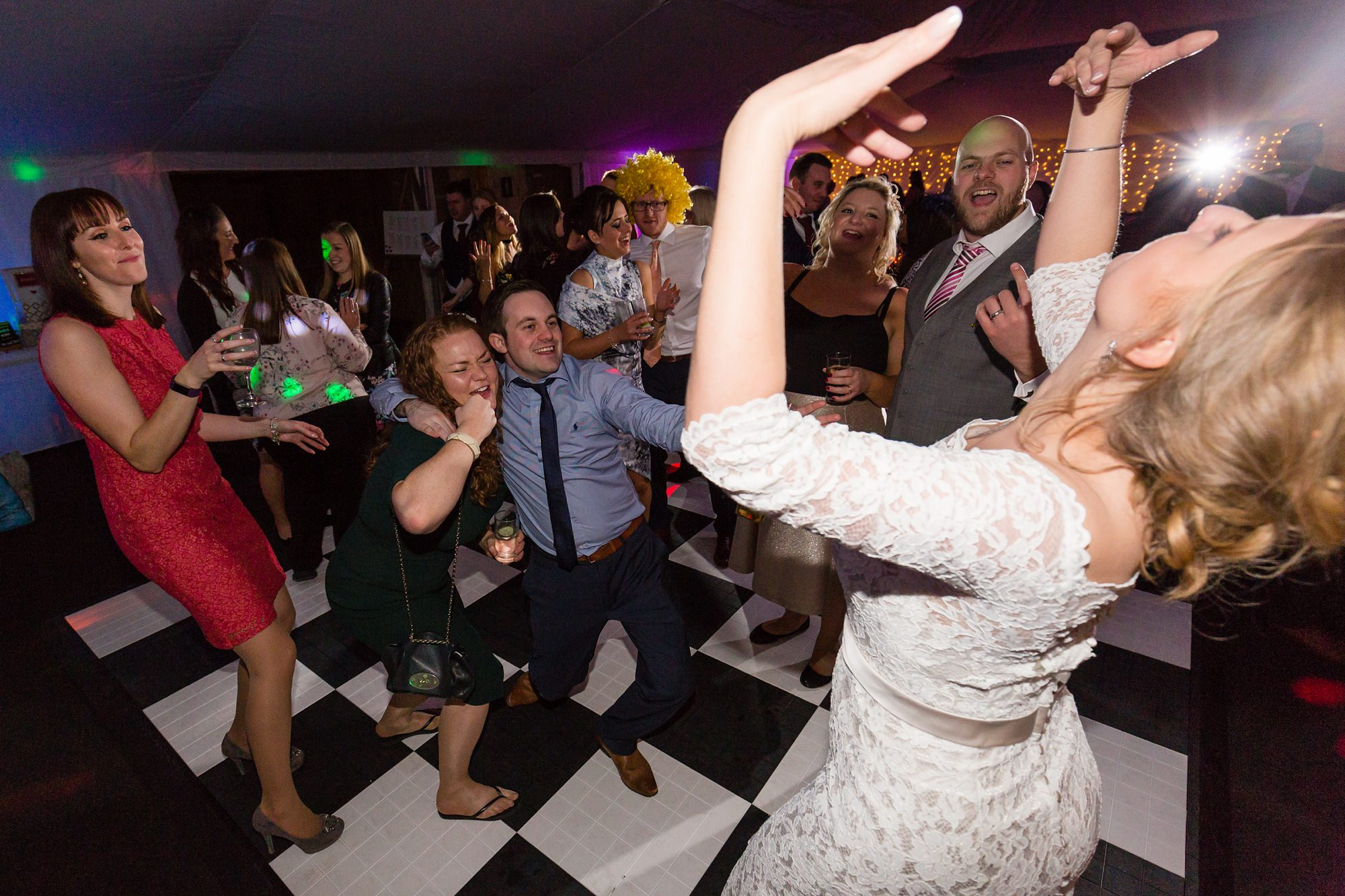Bride dances with guests and acts silly