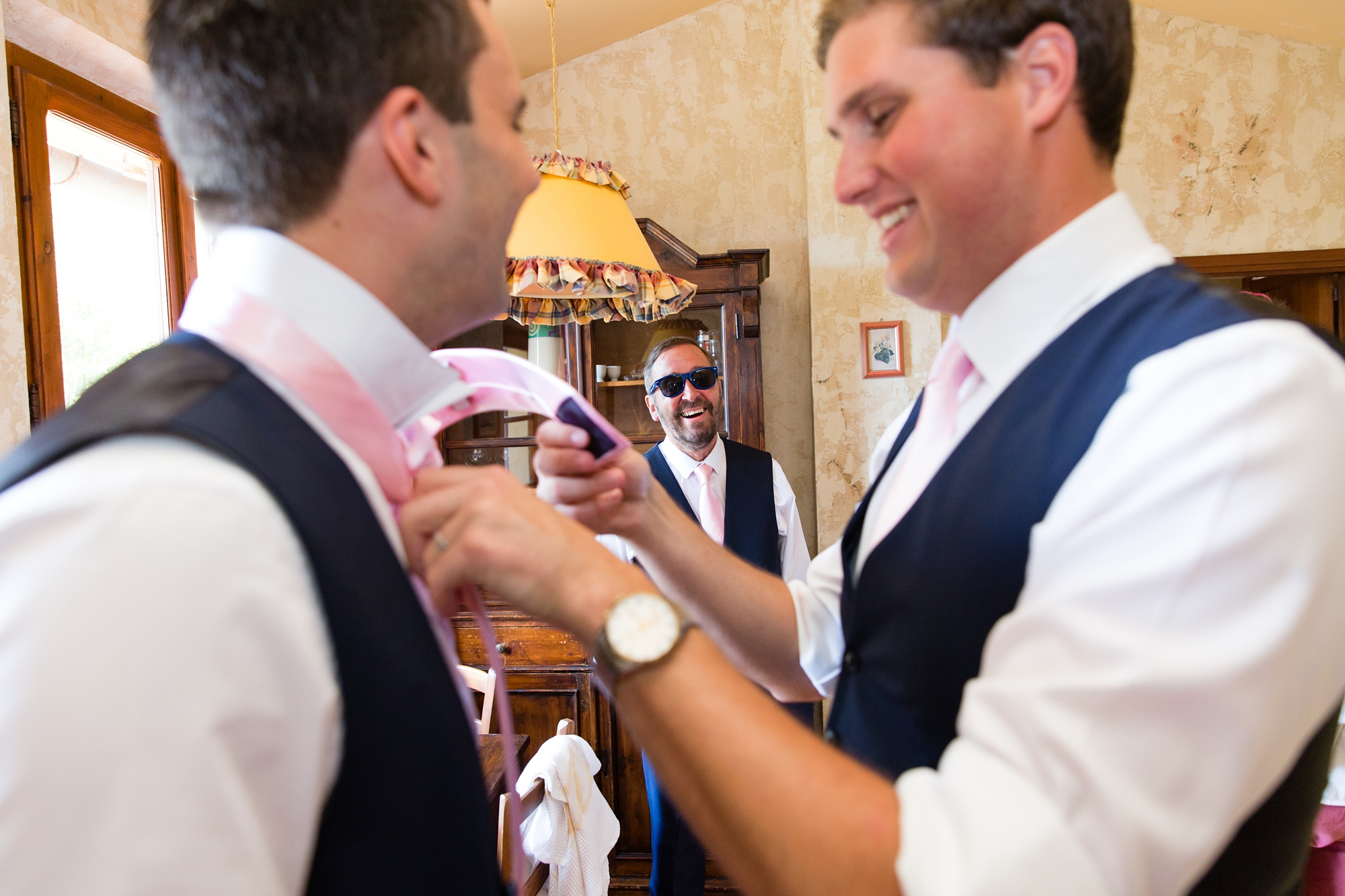 Groom preparation pink ties
