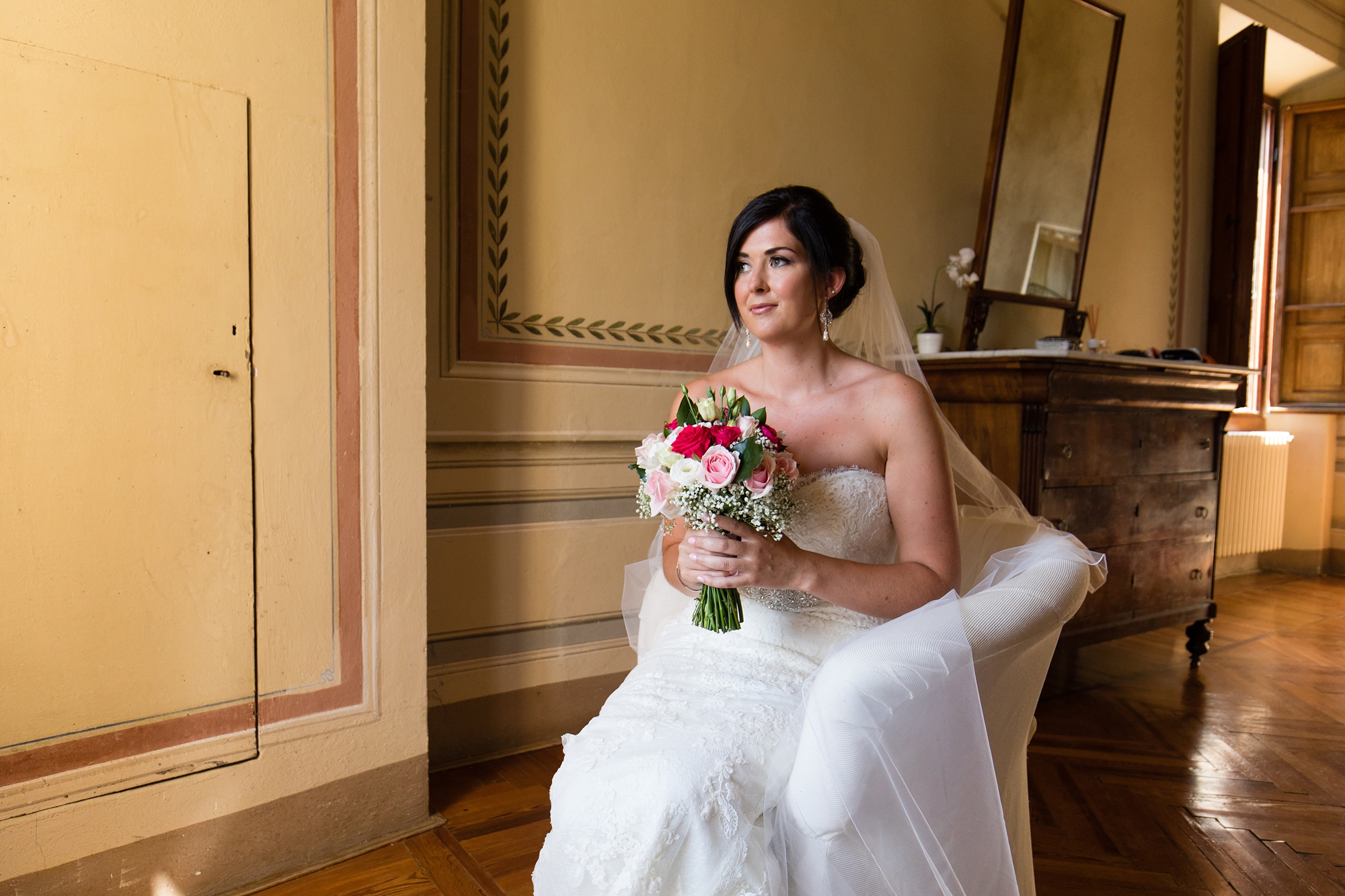 Villa Catignano Siena Wedding Photography bride sits in window