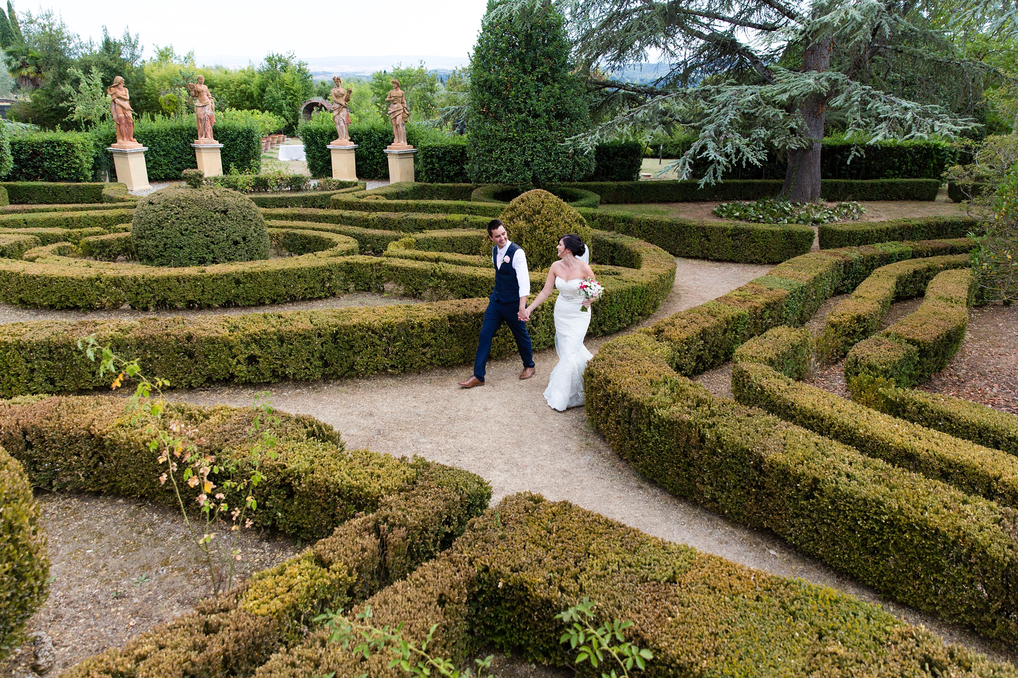 Villa Catignano Siena Wedding Photography couple walks through hedge maze