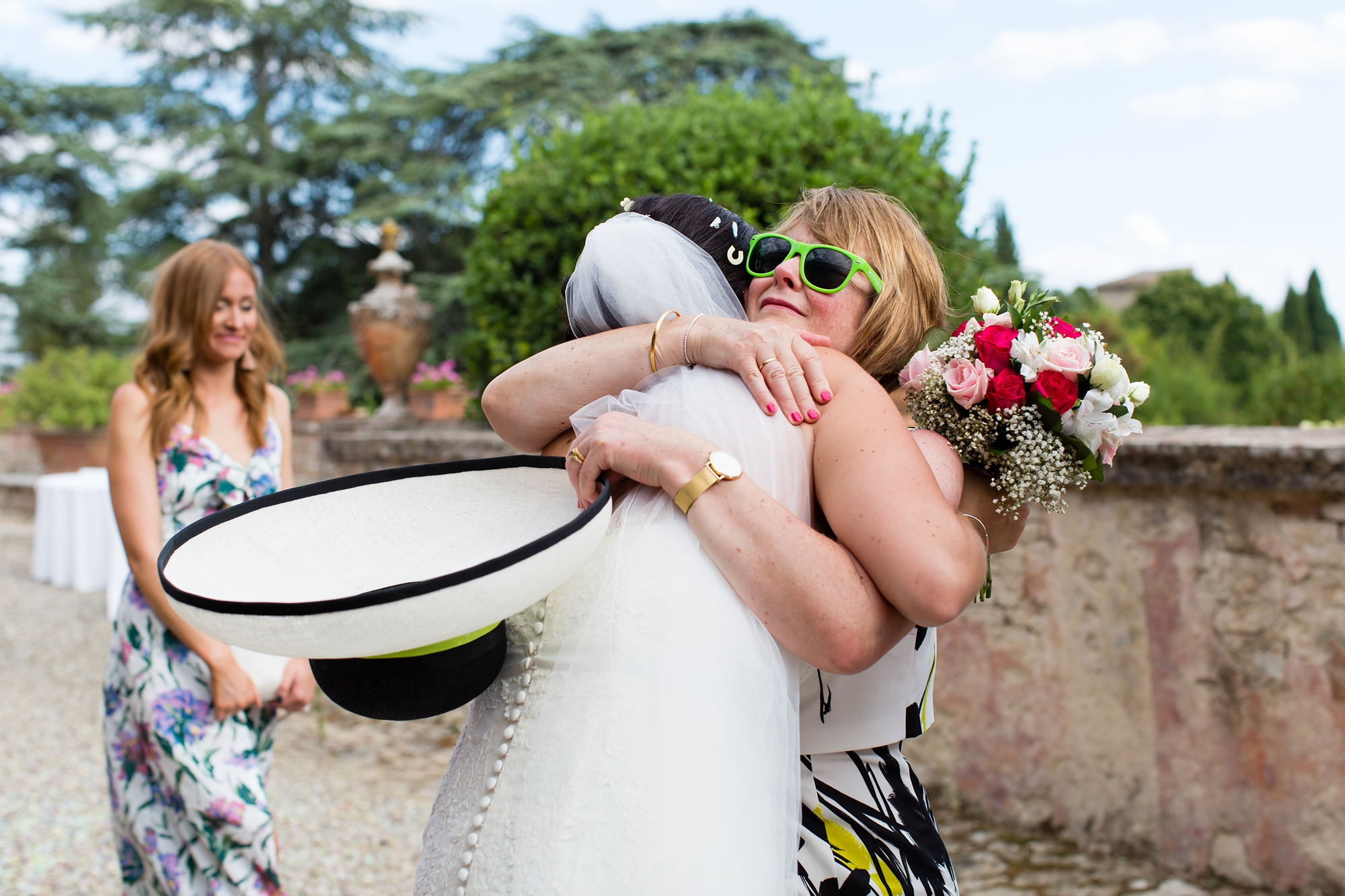 Bride hugs guest at wedding in Italian Villa