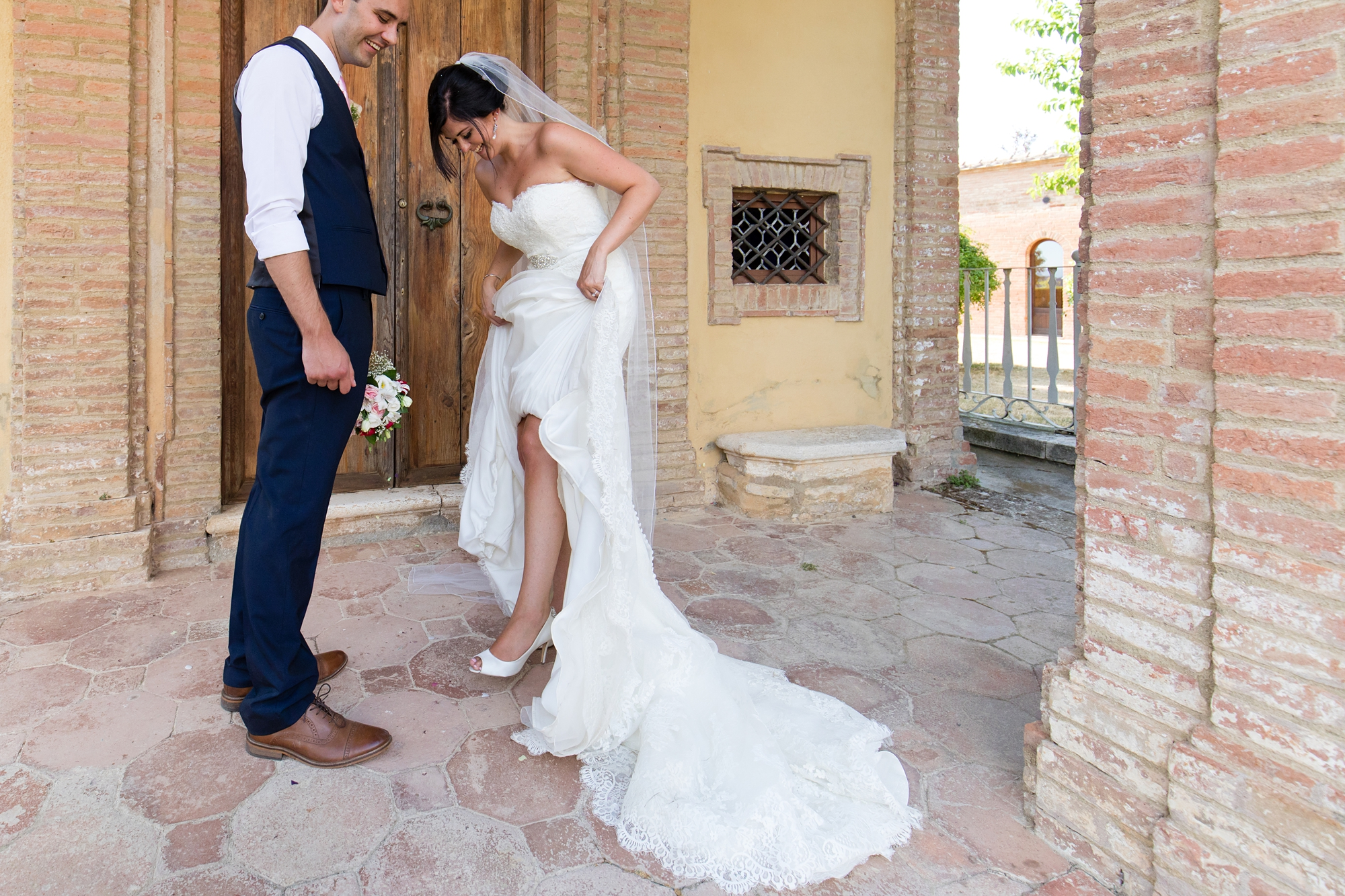 Villa Catignano Siena Wedding Photography bride looks at shoes