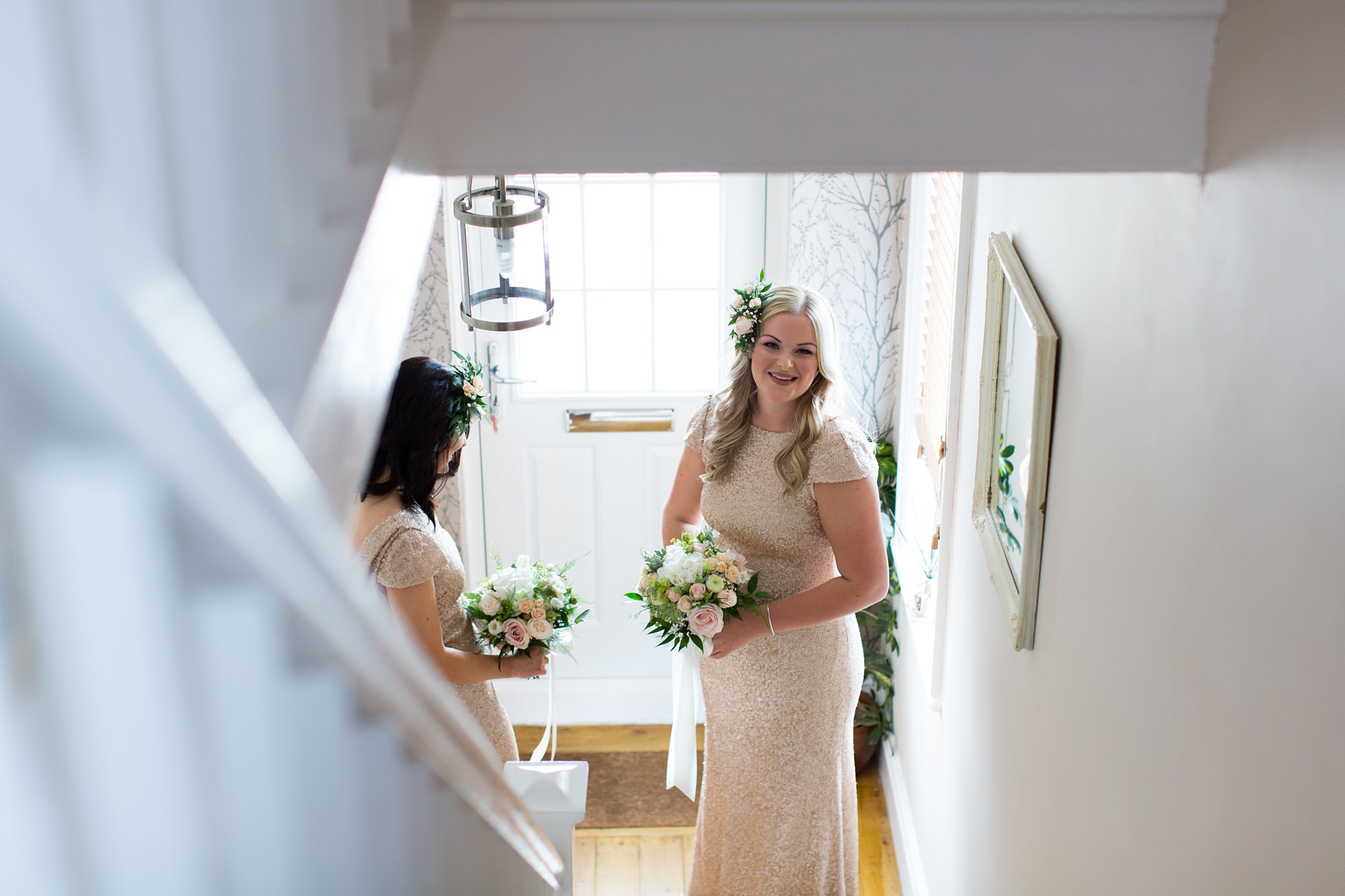 bridesmaids at bottom of the stairs