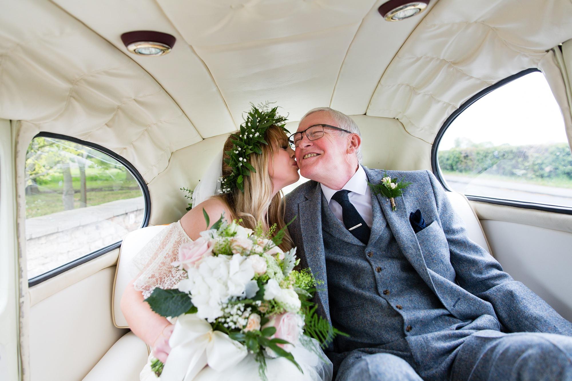 Villa farm wedding photography bride kisses dad