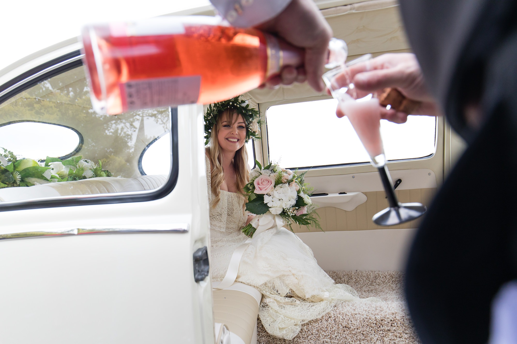 Villa farm wedding photography Bride watches pink champagne poured