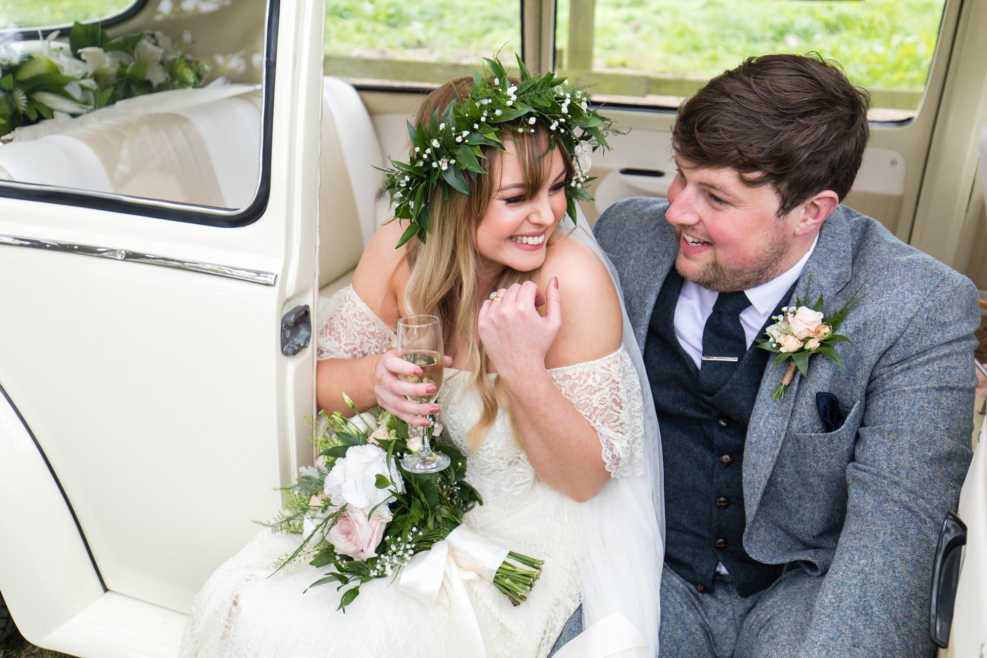Villa farm wedding photography bride and groom sit in vintage VW bug