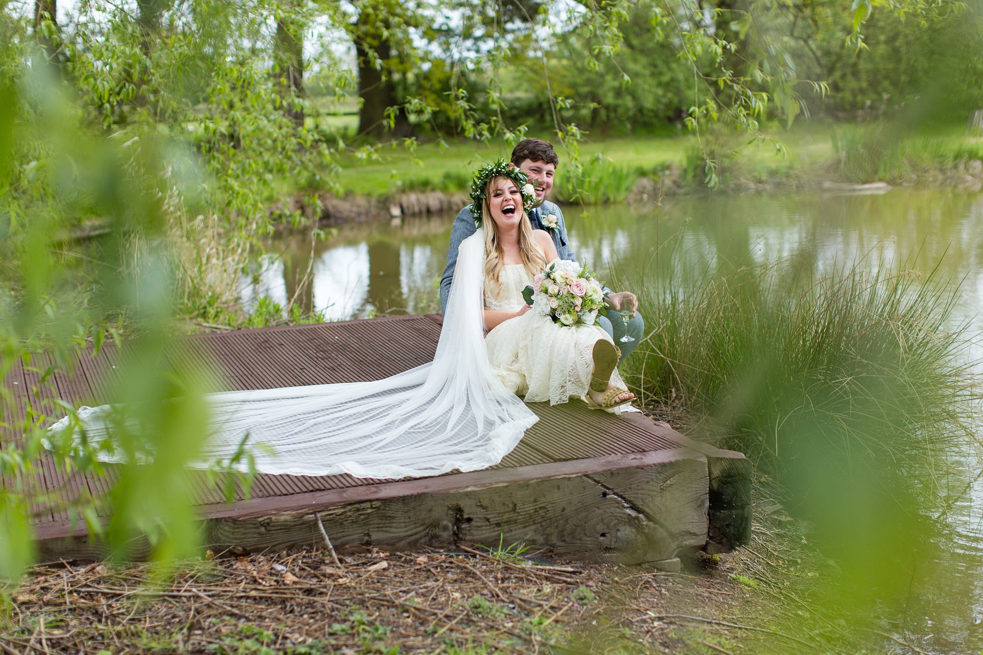 Villa farm wedding photography Fun laughing couple on pier