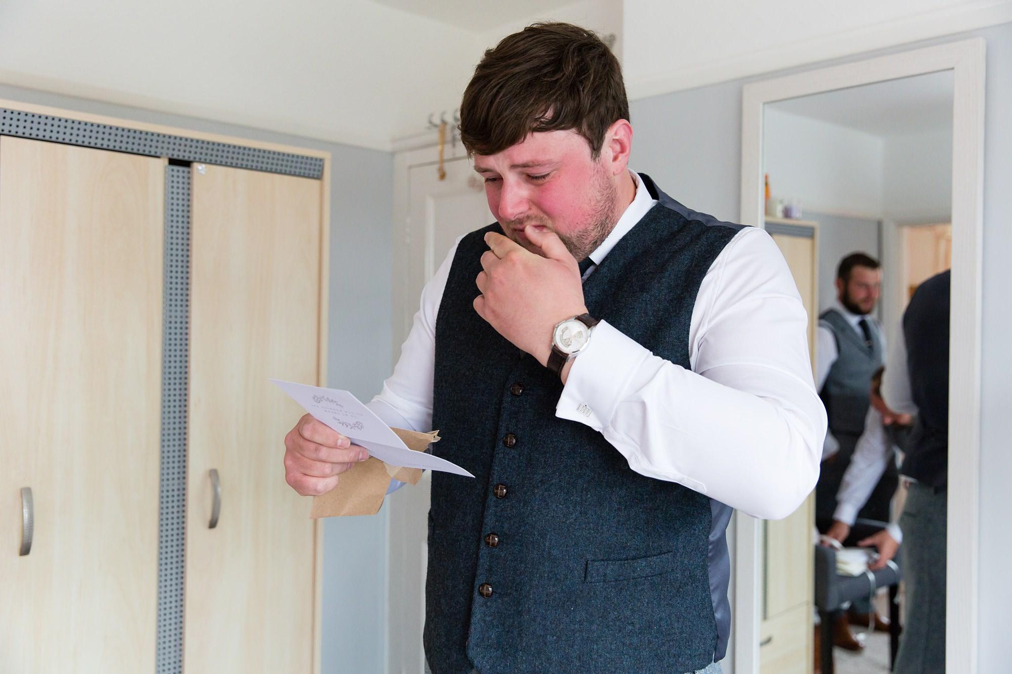 Villa farm wedding photography groom cries reading bride's letter