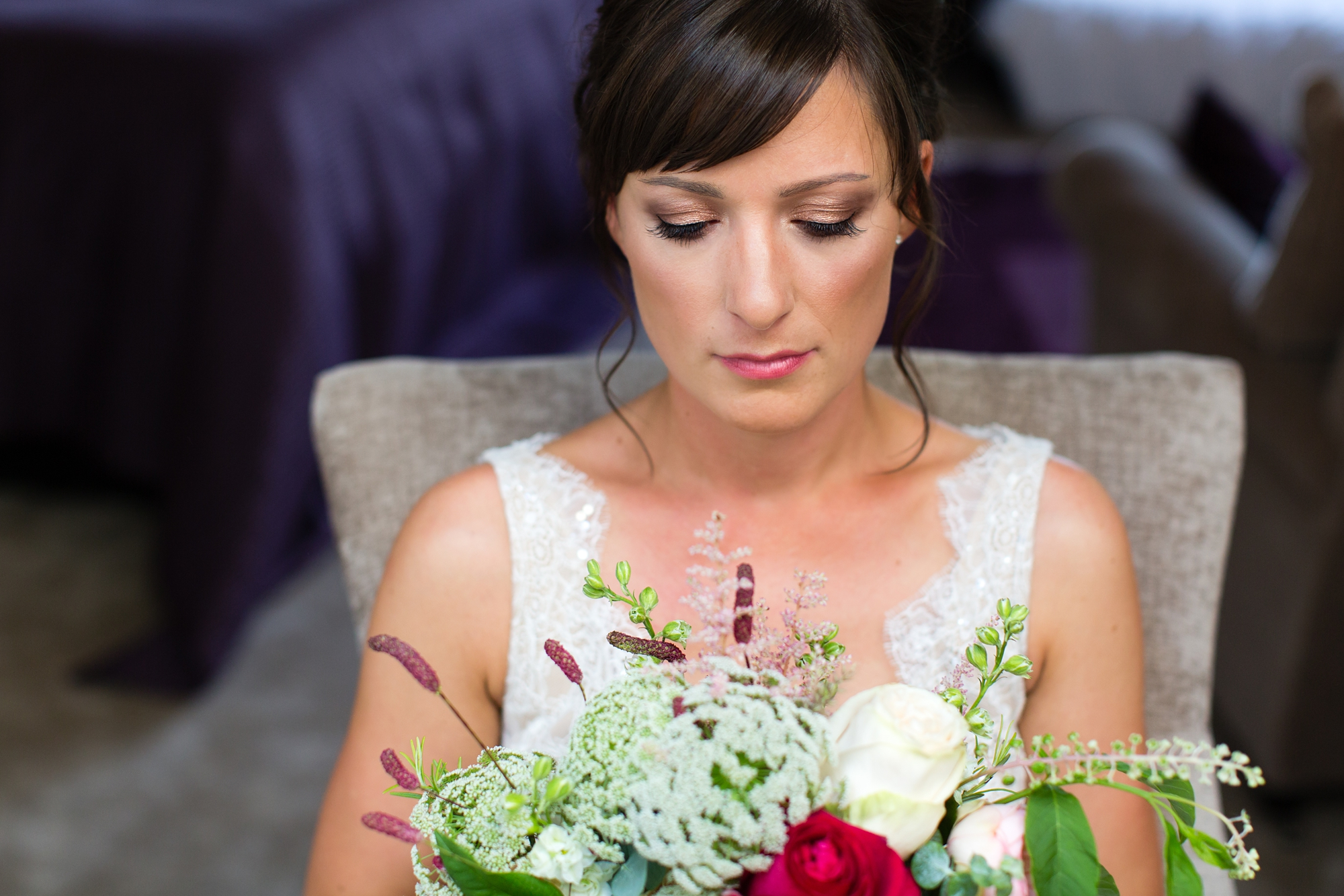 York & Albany Wedding Photography bride looking at bouquet