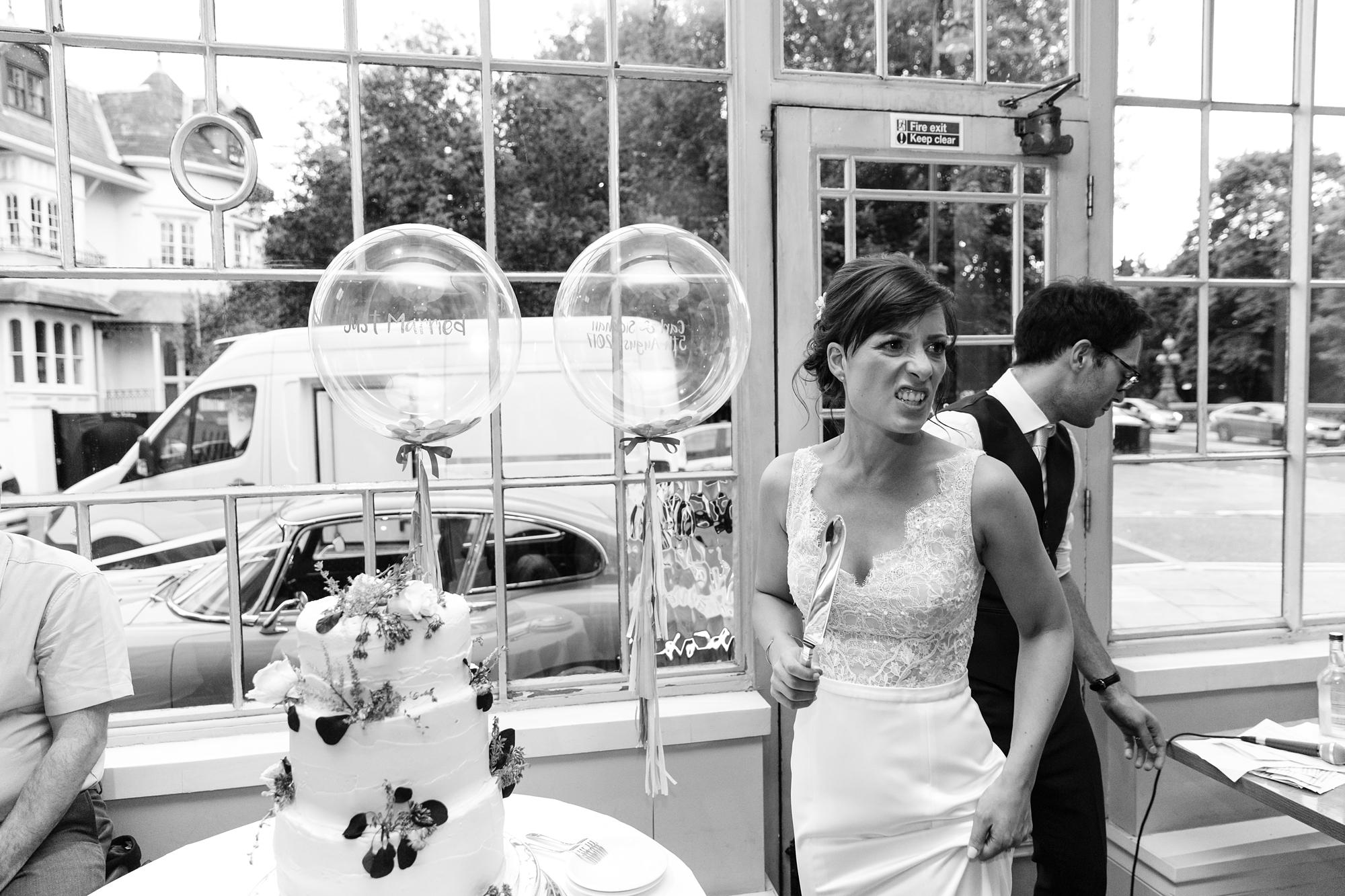 York & Albany Wedding Photography funny cake cut