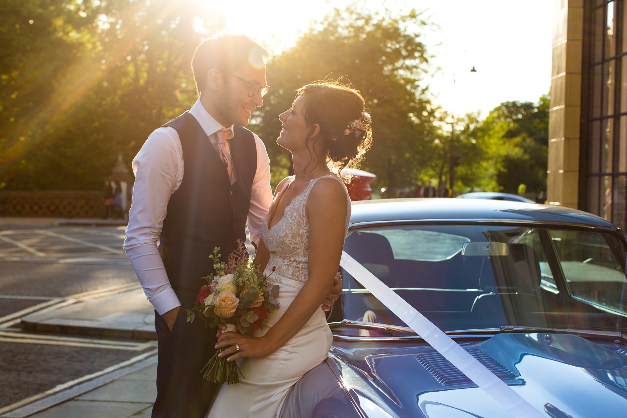 Bride and groom on Jaguar e type york wedding photography