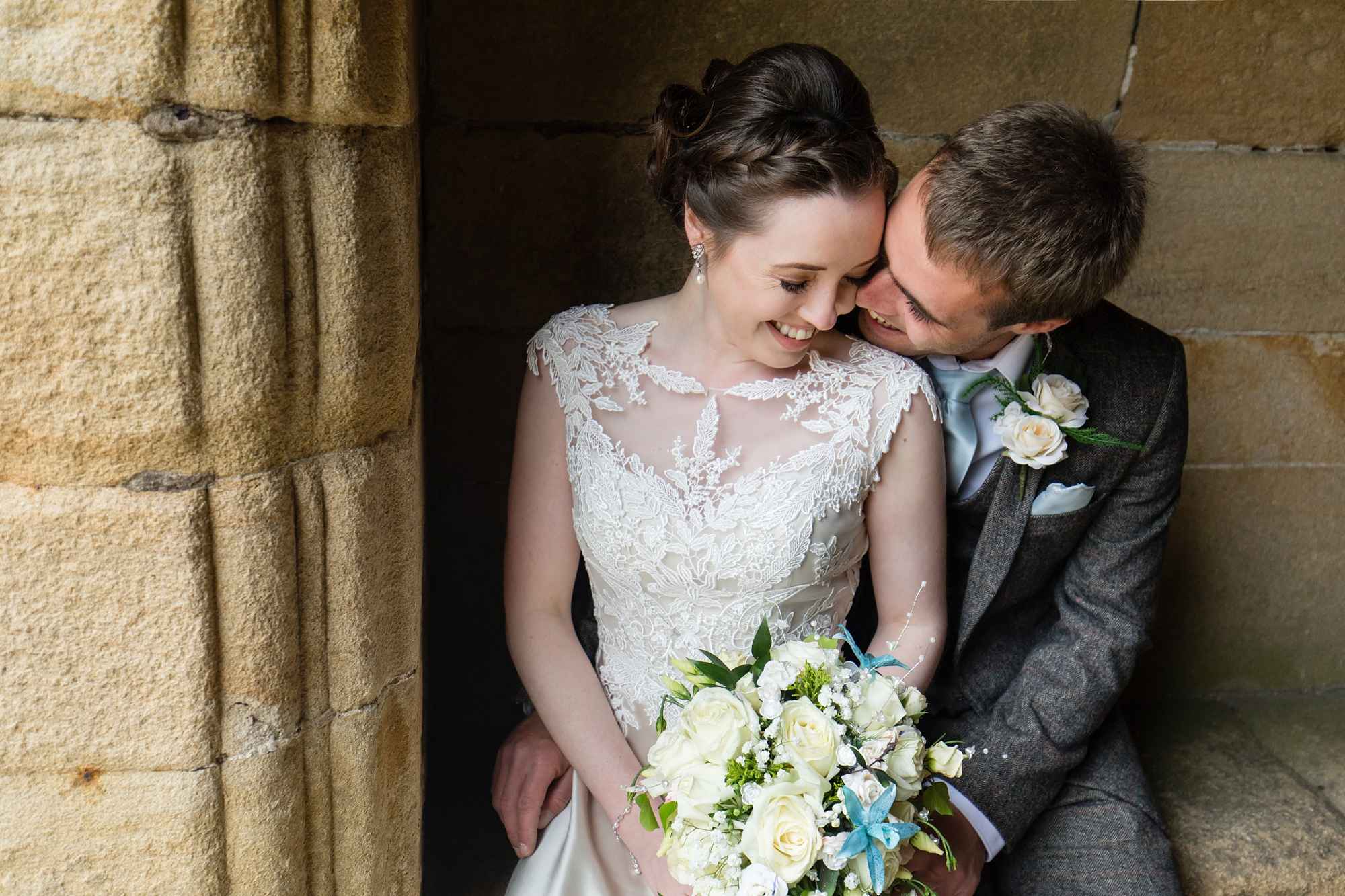 Couple kiss and cuddle at york wedding