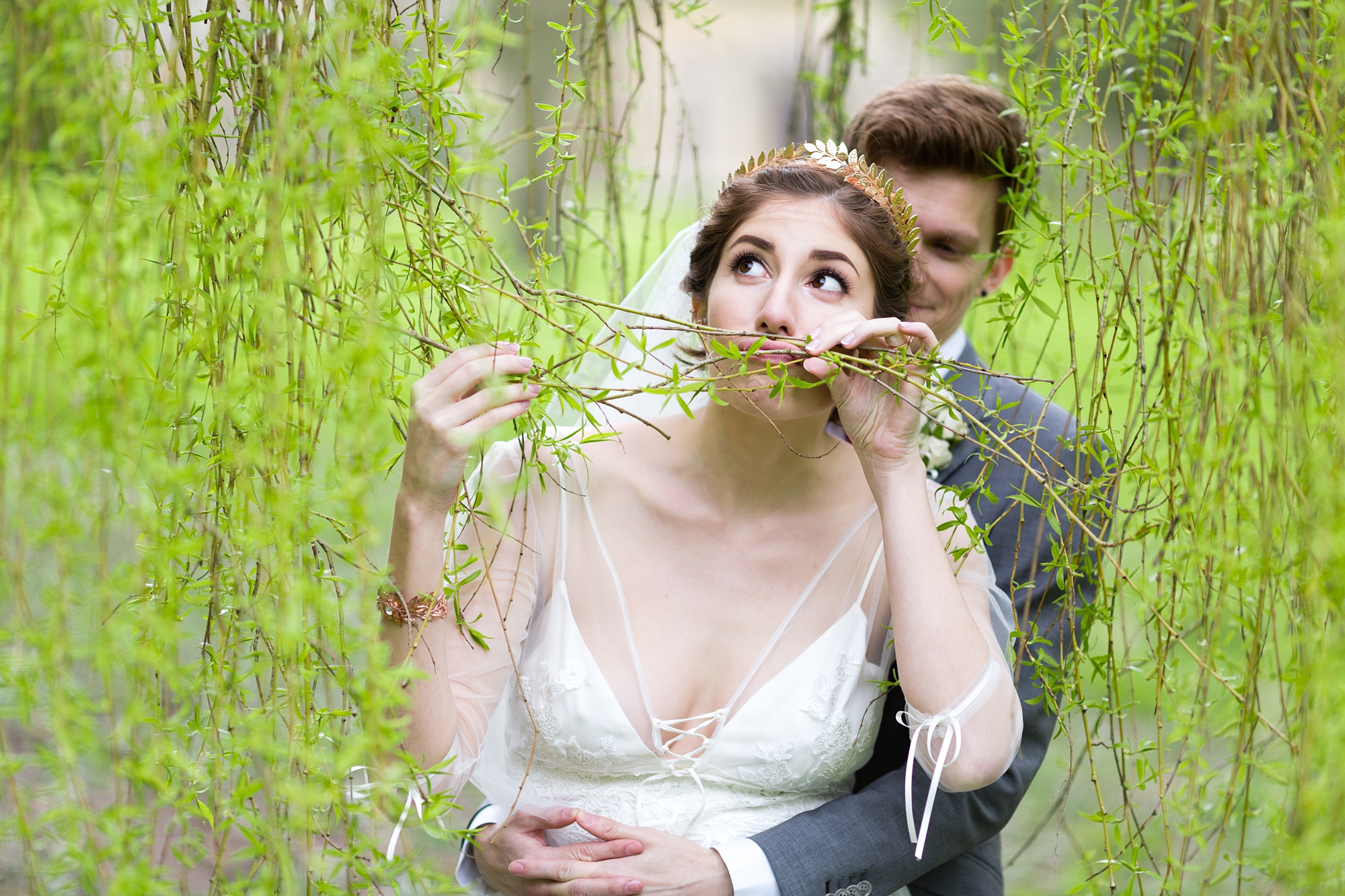 York wedding photography bride making silly face with tree