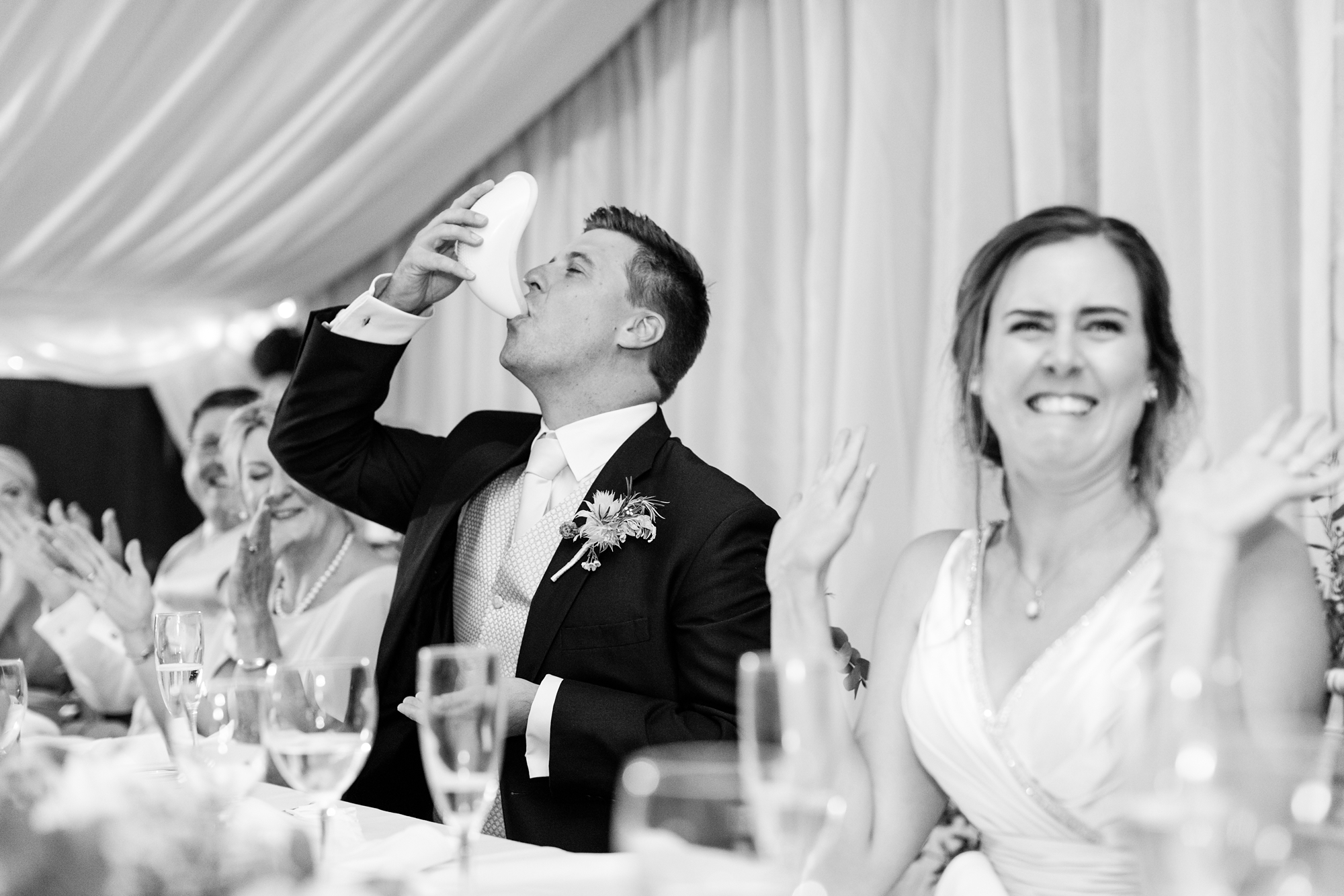 Groom drinking out of cricket box and bride makes funny face york wedding photography