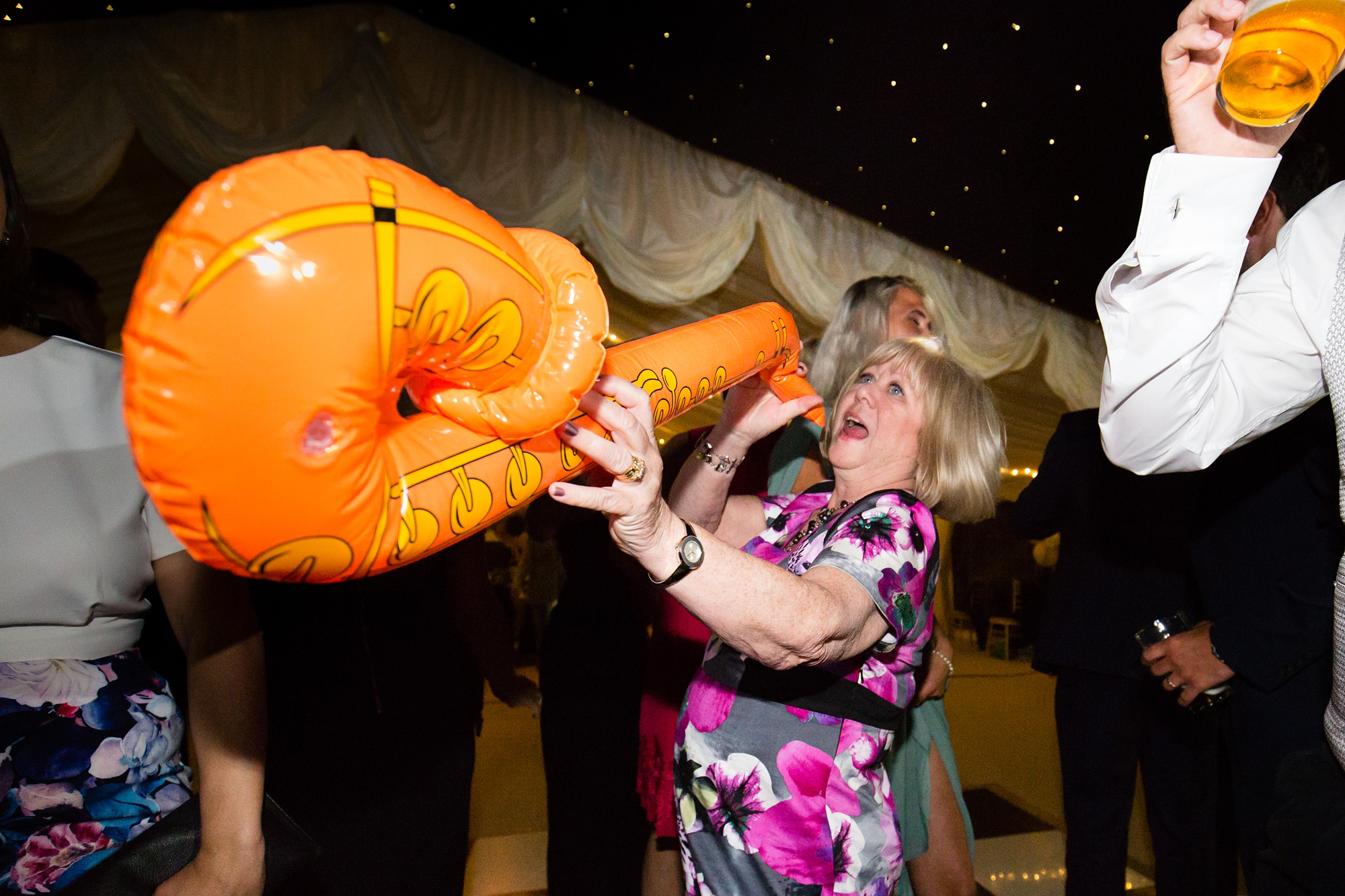 Guest playing blow up saxophone for york wedding