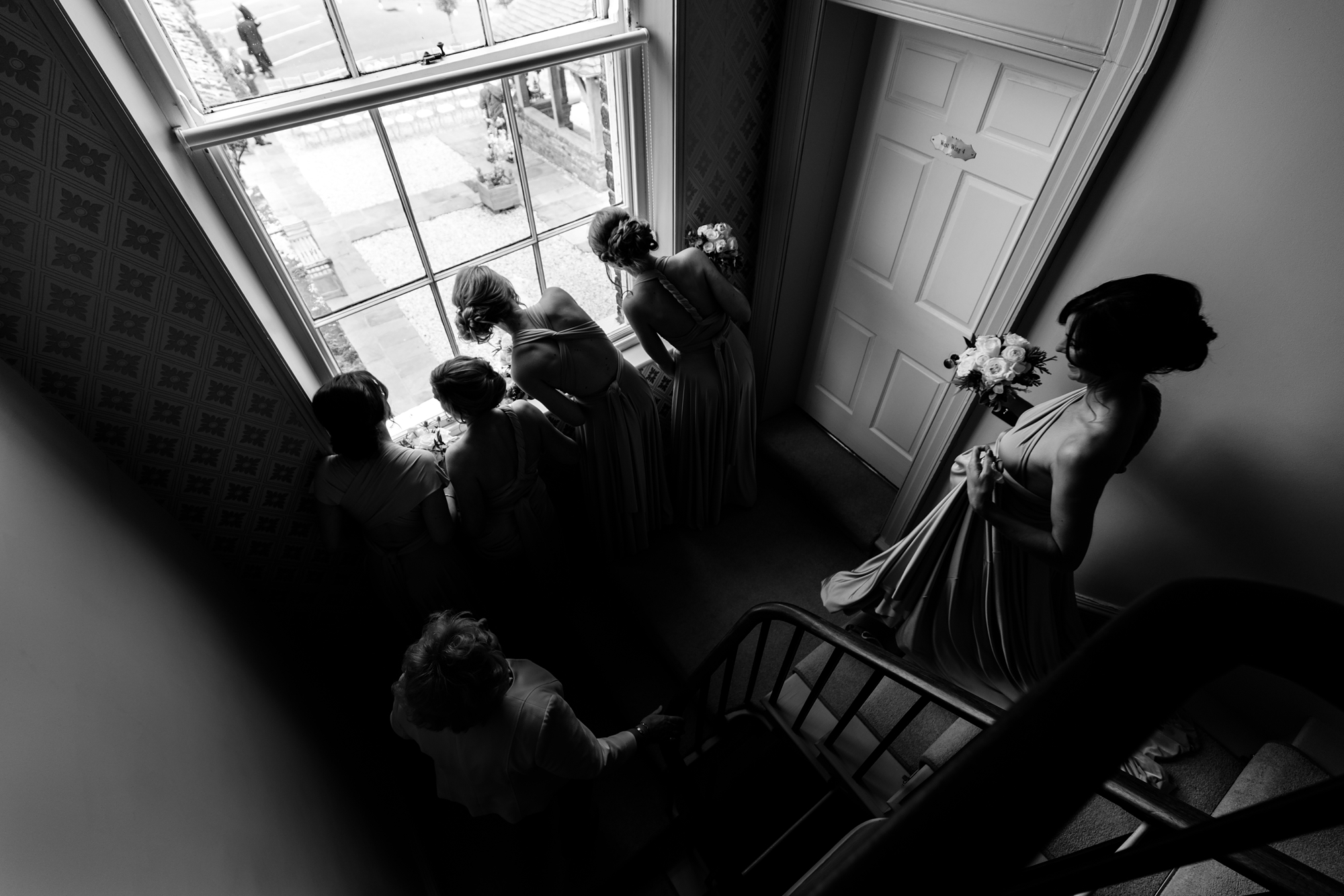 Bridesmaids look out window at york wedding