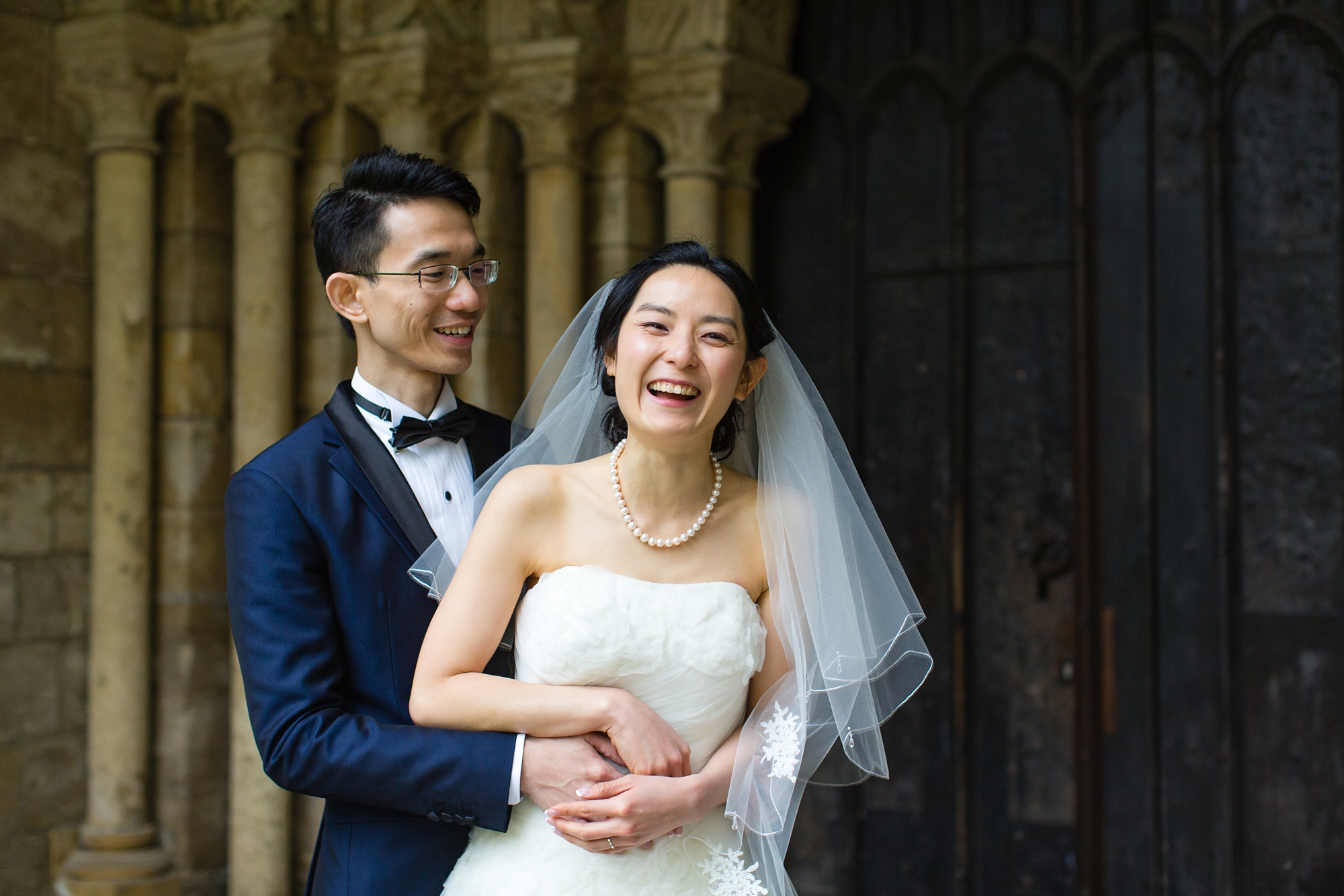 Couple laugh outside of church wedding in york