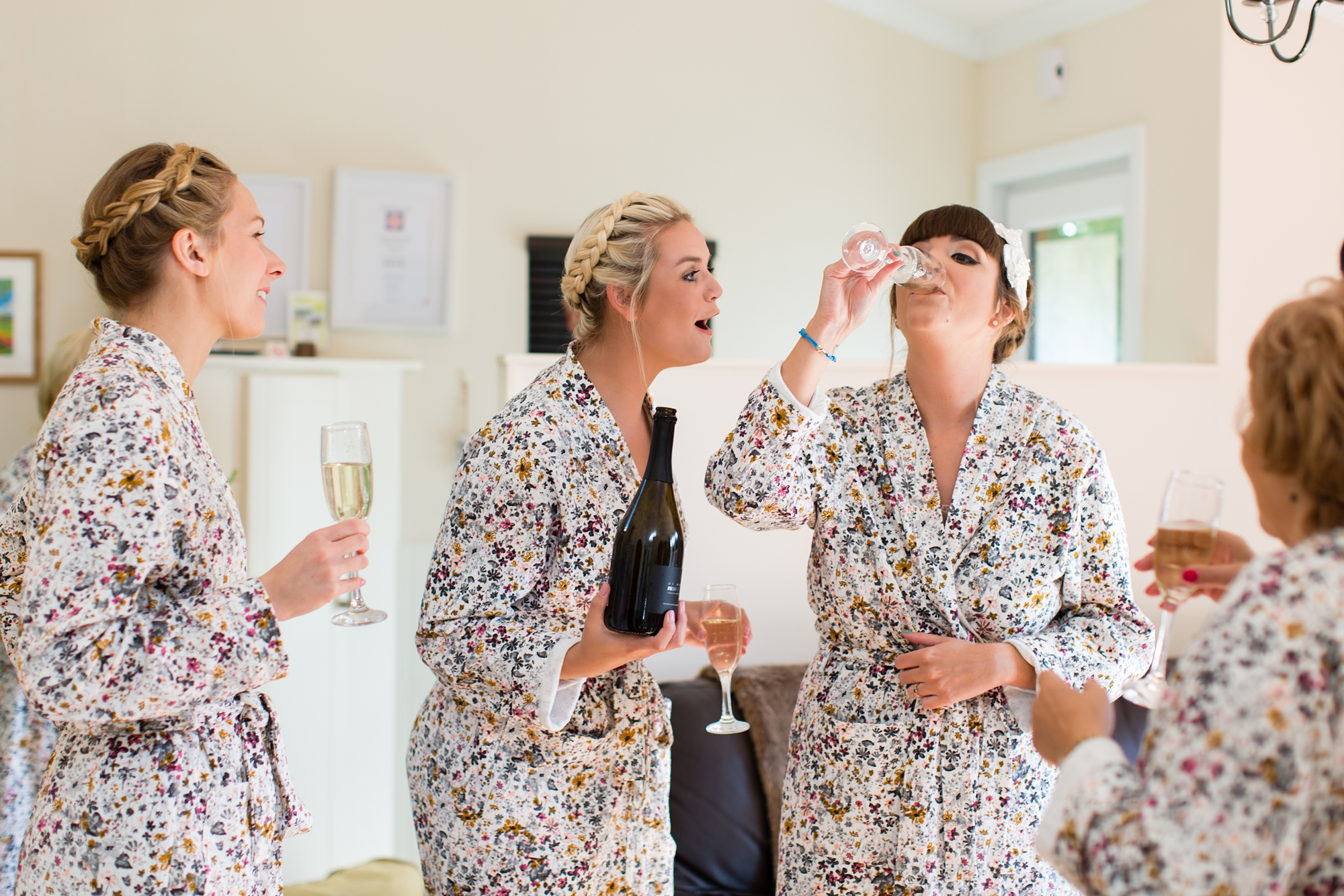 Bride drinking champagne York Wedding Photography at Barmbyfield Barns