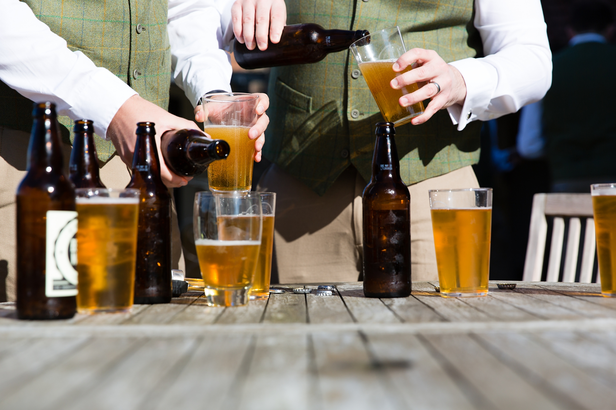 York Wedding Photography at Barmbyfield Barns groom pouring beers