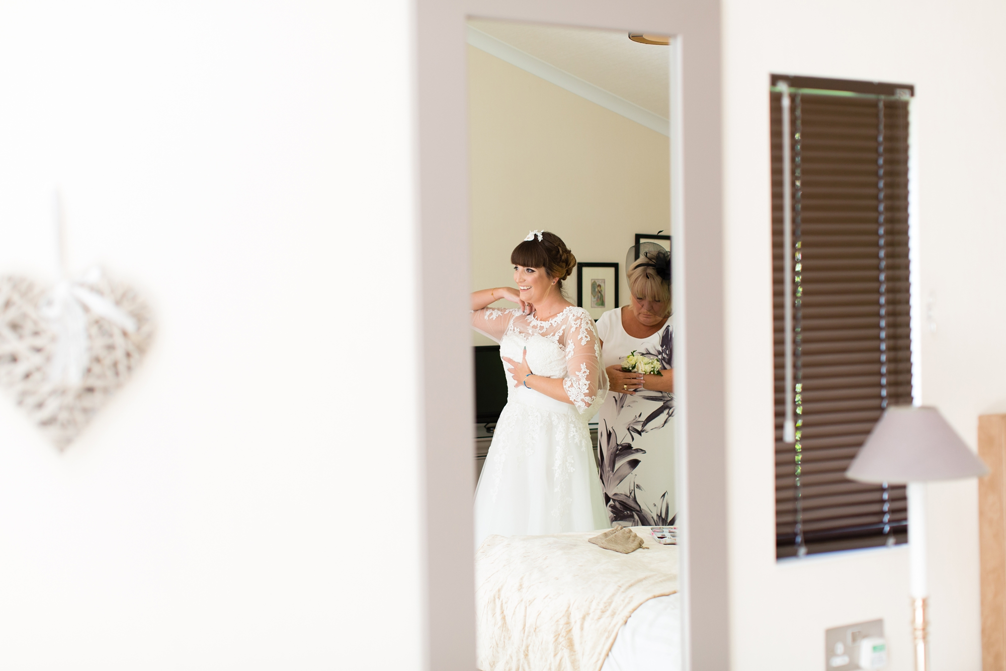 York Wedding Photography at Barmbyfield Barns bride getting into dress in mirror