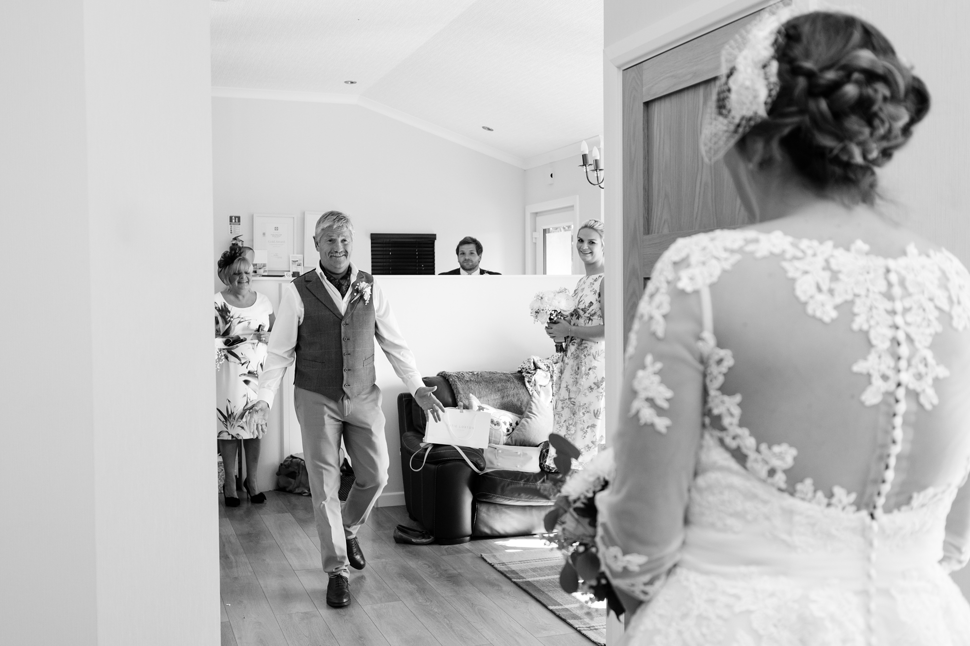 Dad eeing daughter for the first time York Wedding Photography at Barmbyfield Barns