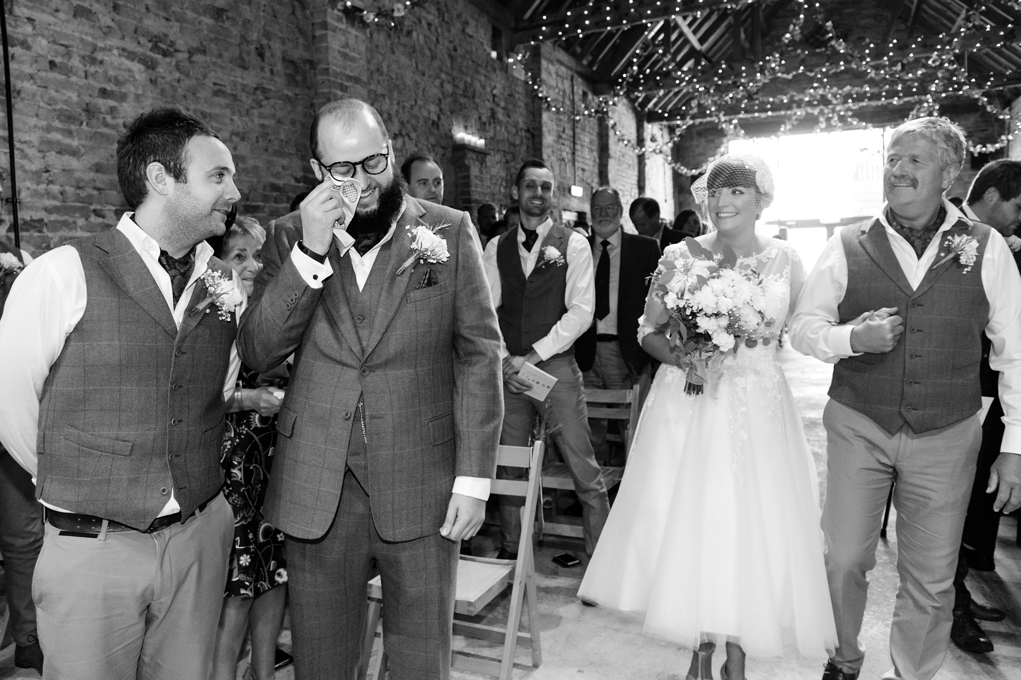 York Wedding Photography at Barmbyfield Barns bride walks up to top of aisle as groom cries