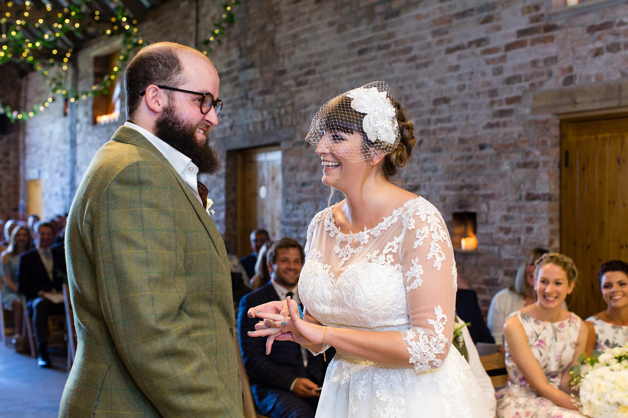 York Wedding Photography at Barmbyfield Barns exchange of rings in ceremony