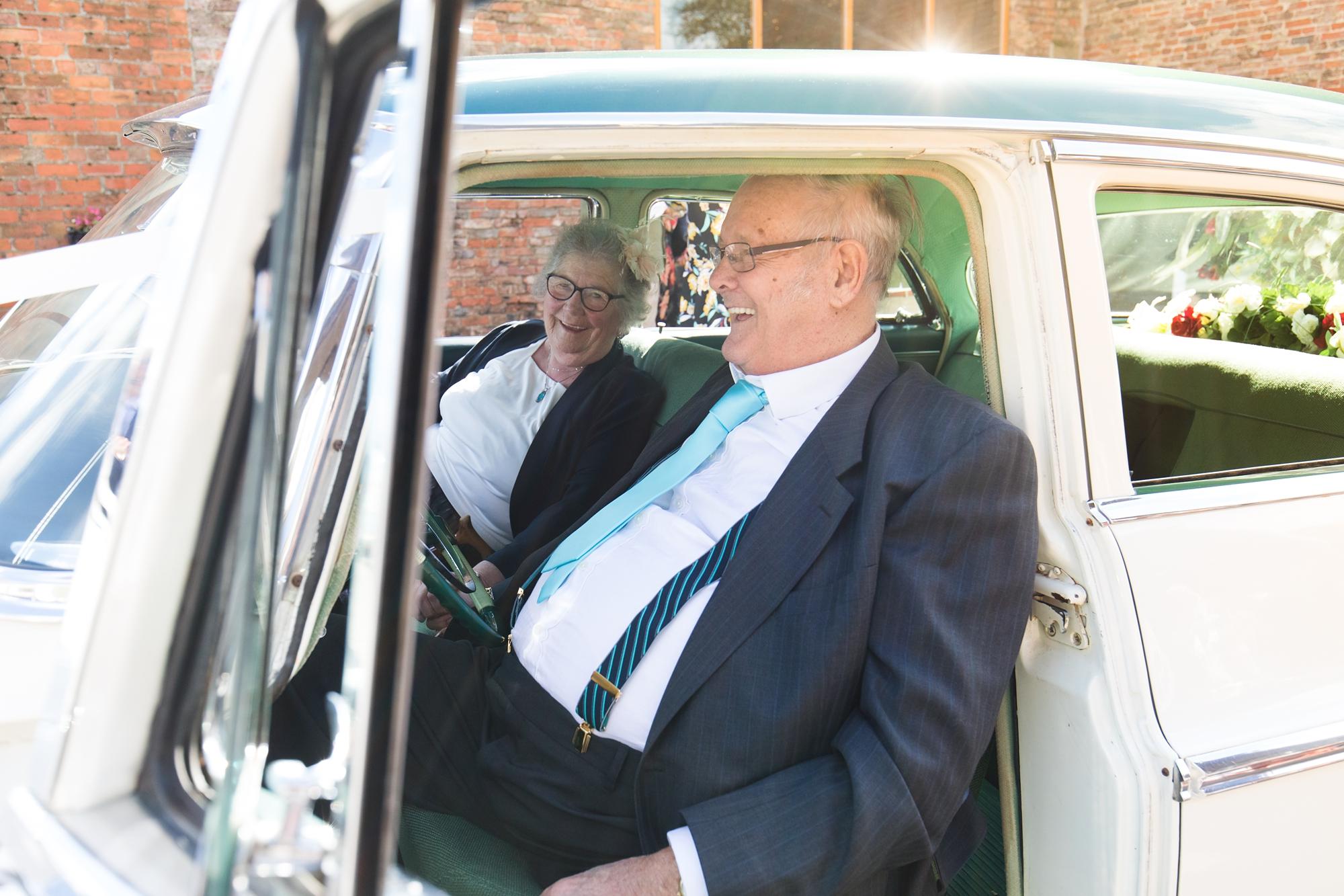 grandparents in classic car