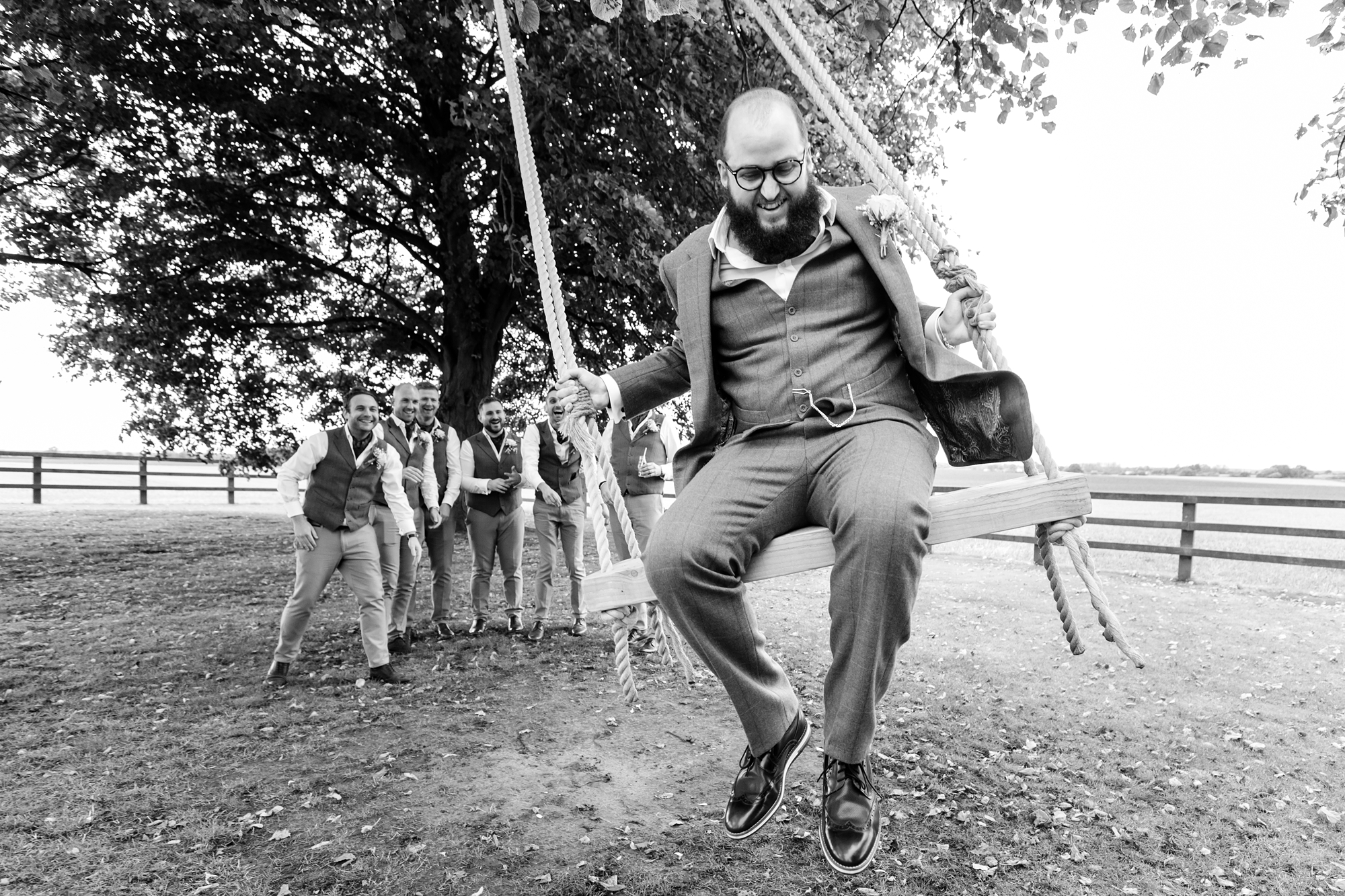 York Wedding Photography at Barmbyfield Barns funny photo of groom on swing