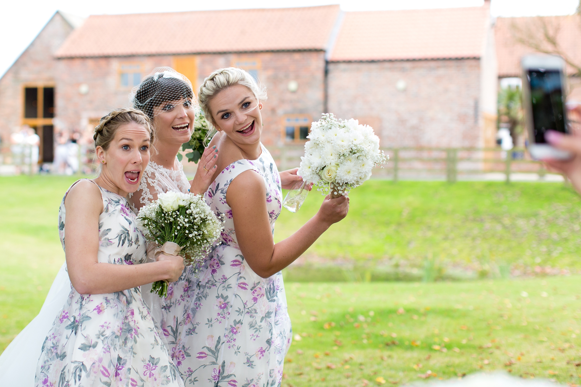 York Wedding Photography at Barmbyfield Barns bridesmiads making silly faces